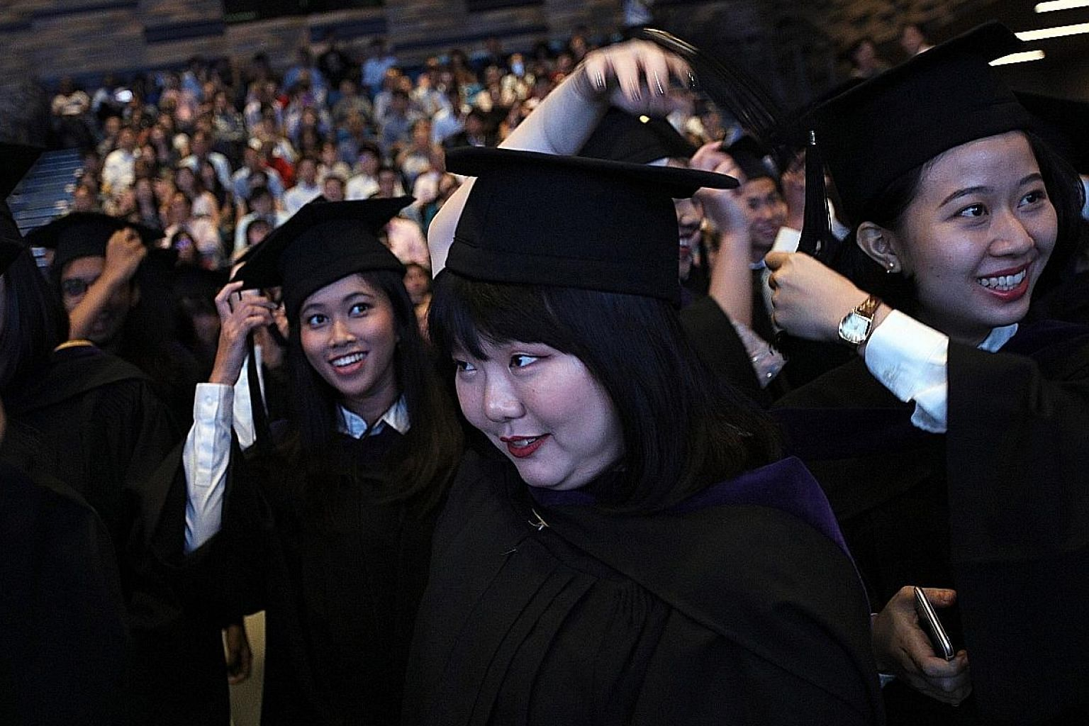 Graduates at a Singapore Management University commencement ceremony in 2017. Education Minister Ong Ye Kung said that as announced in 2012, the university participation rate will effectively rise to 50 per cent. But he also stressed the importance o