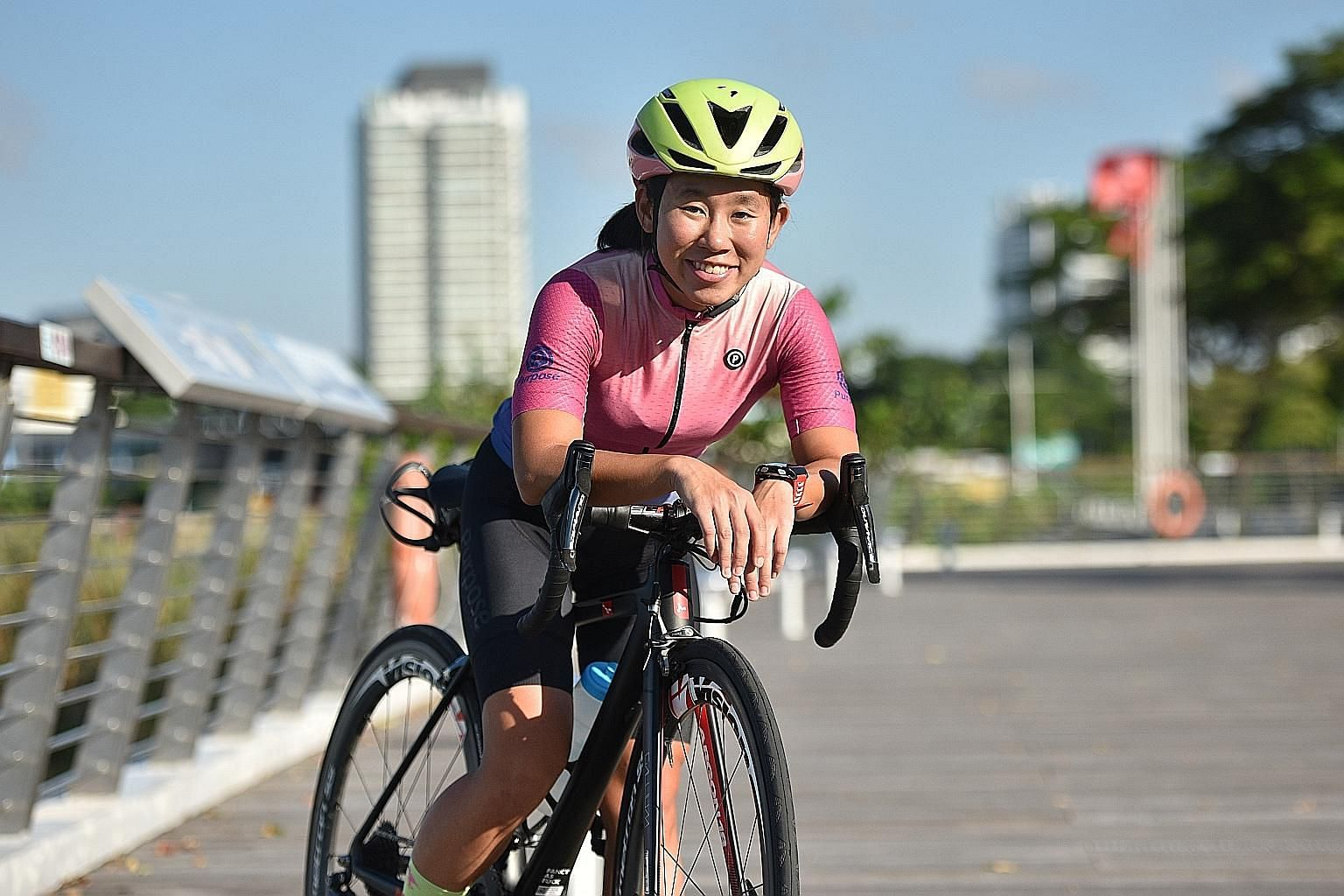 Charlene Tang, 25, cycling along the Kallang River. She will take part in OCBC Cycle's The Straits Times Ride for the first time on May 10. ST PHOTO: KELLY HUI
