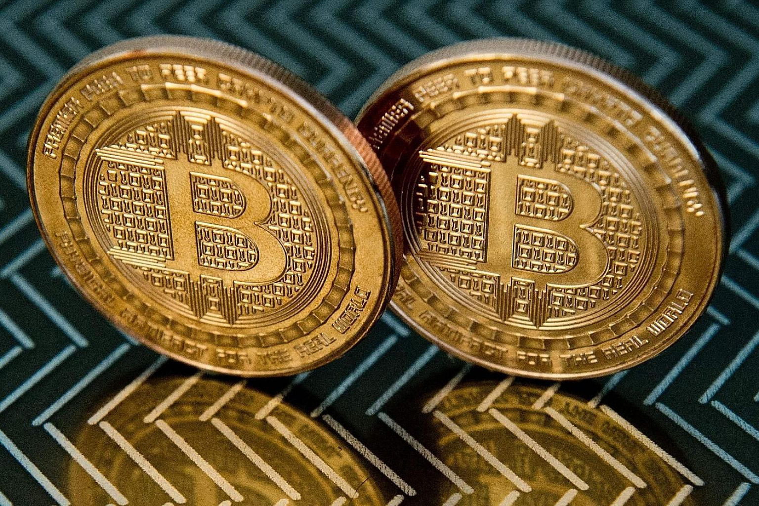 The Payment Services Act is the first comprehensive regulation for companies handling activities ranging from digital payments to trading of tokens such as bitcoin and Ether. PHOTO: AGENCE FRANCE-PRESSE