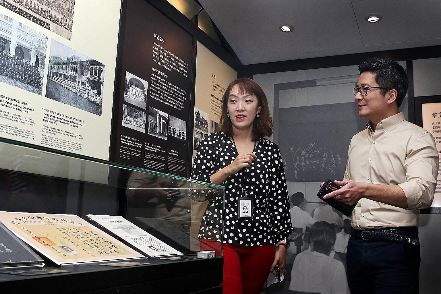 Ms Jermaine Chua, curator of Sun Yat Sen Nanyang Memorial Hall, and Mr Alvin Tan, deputy chief executive for policy and community at the National Heritage Board, introducing an exhibit at Gallery 4 - Chinese Business Pioneers yesterday. The revamped