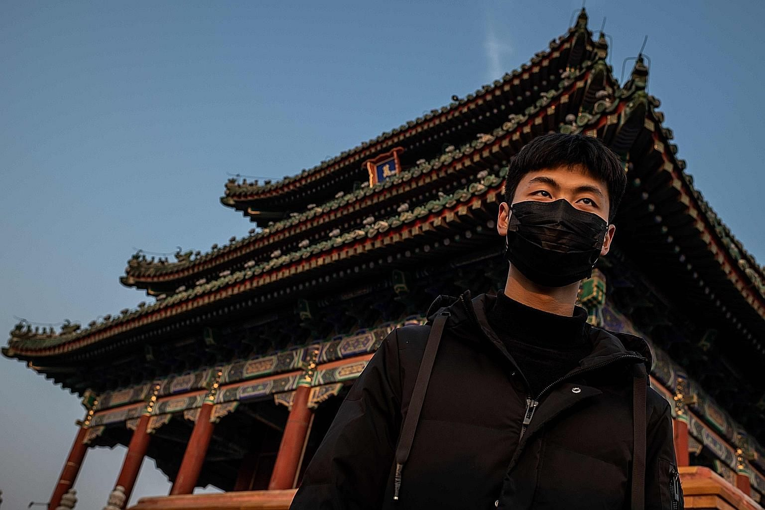 A man wearing a protective mask at Jingshan park in Beijing on Jan 25, amid the coronavirus epidemic. Critics have blamed the contagion on a lack of transparency, a slow start to quarantining suspected carriers and officials initially playing down, i
