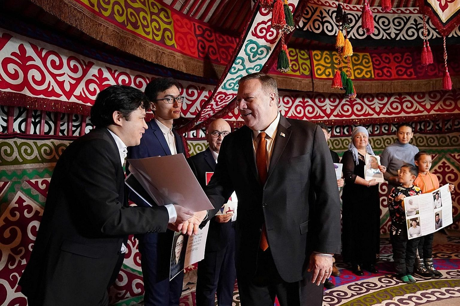 Kazakh Foreign Minister Mukhtar Tleuberdi (above) focused on economic and security cooperation in his talks with Mr Pompeo. US Secretary of State Mike Pompeo meeting Kazakh citizens in a yurt at the US Ambassador's residence in Nur-Sultan yesterday.