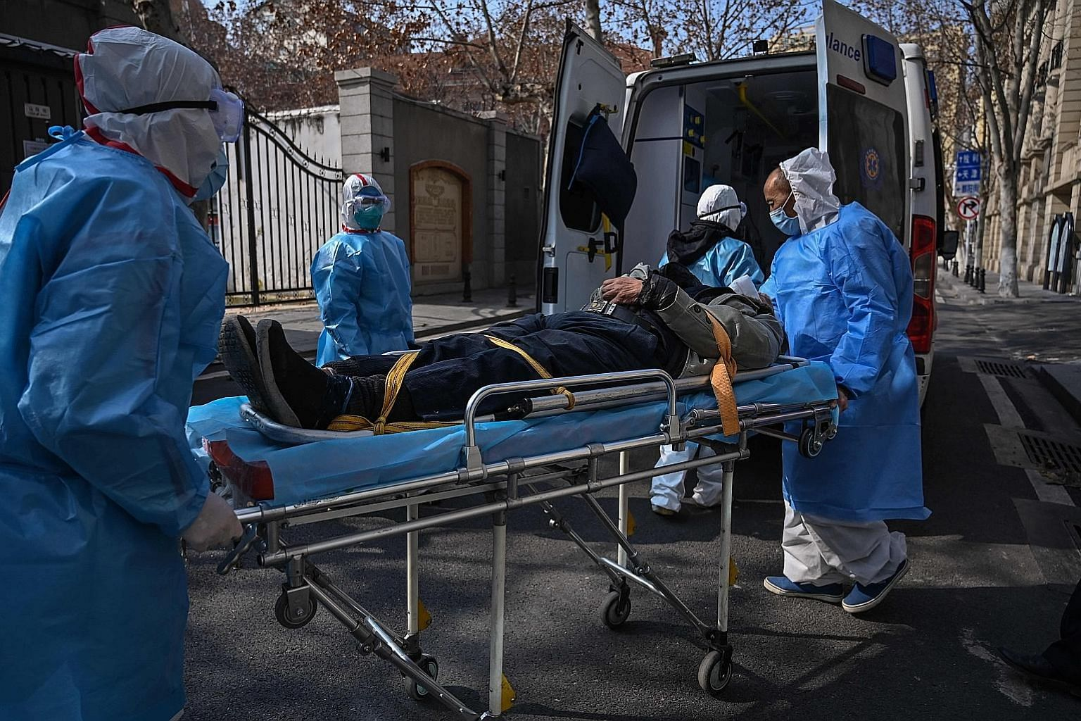 Medical staff taking away a patient suspected of having contracted the Wuhan virus in the city in China's Hubei province last Thursday. Asean's tourism sector will be affected, after China ordered all tour groups to be suspended until the virus is co
