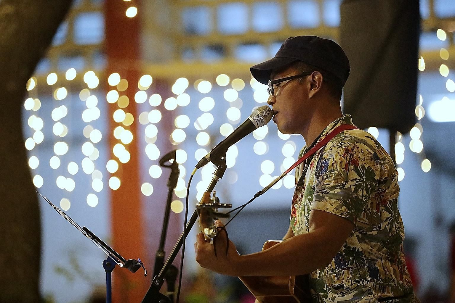Leo performing at last night's Chinese New Year dinner at Transit Point, an interim shelter for the homeless in Margaret Drive. He was homeless for a few months after being released from prison for drug offences last year, and is currently staying at