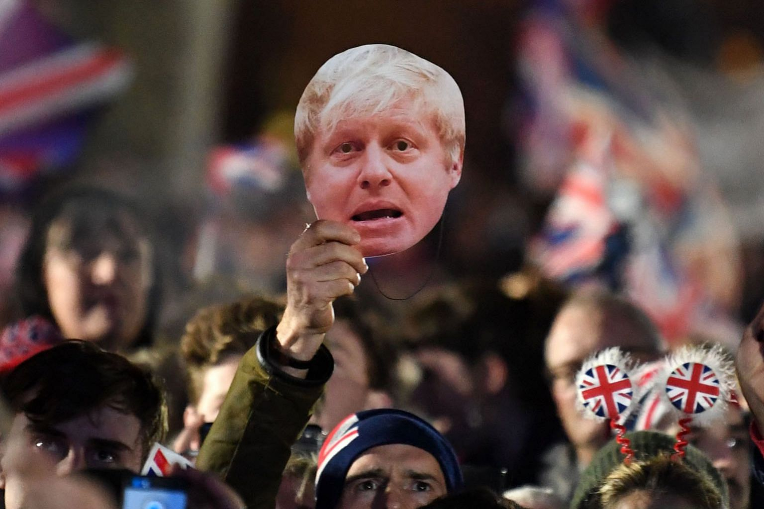 Brexit supporters in London waving Union flags and a mask of British Prime Minister Boris Johnson as the clock ticked down to Britain's departure from the European Union at 11pm last Friday.