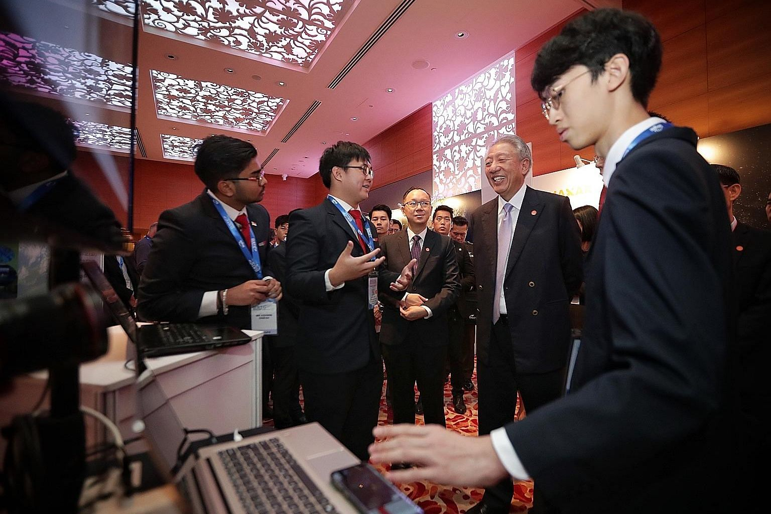 Senior Minister and Coordinating Minister for National Security Teo Chee Hean with Singapore Polytechnic students (from left) Ashwin Dinesh, Davis Zheng and Tristan Voon at the 12th Global Space and Technology Convention in Grand Hyatt Singapore yest