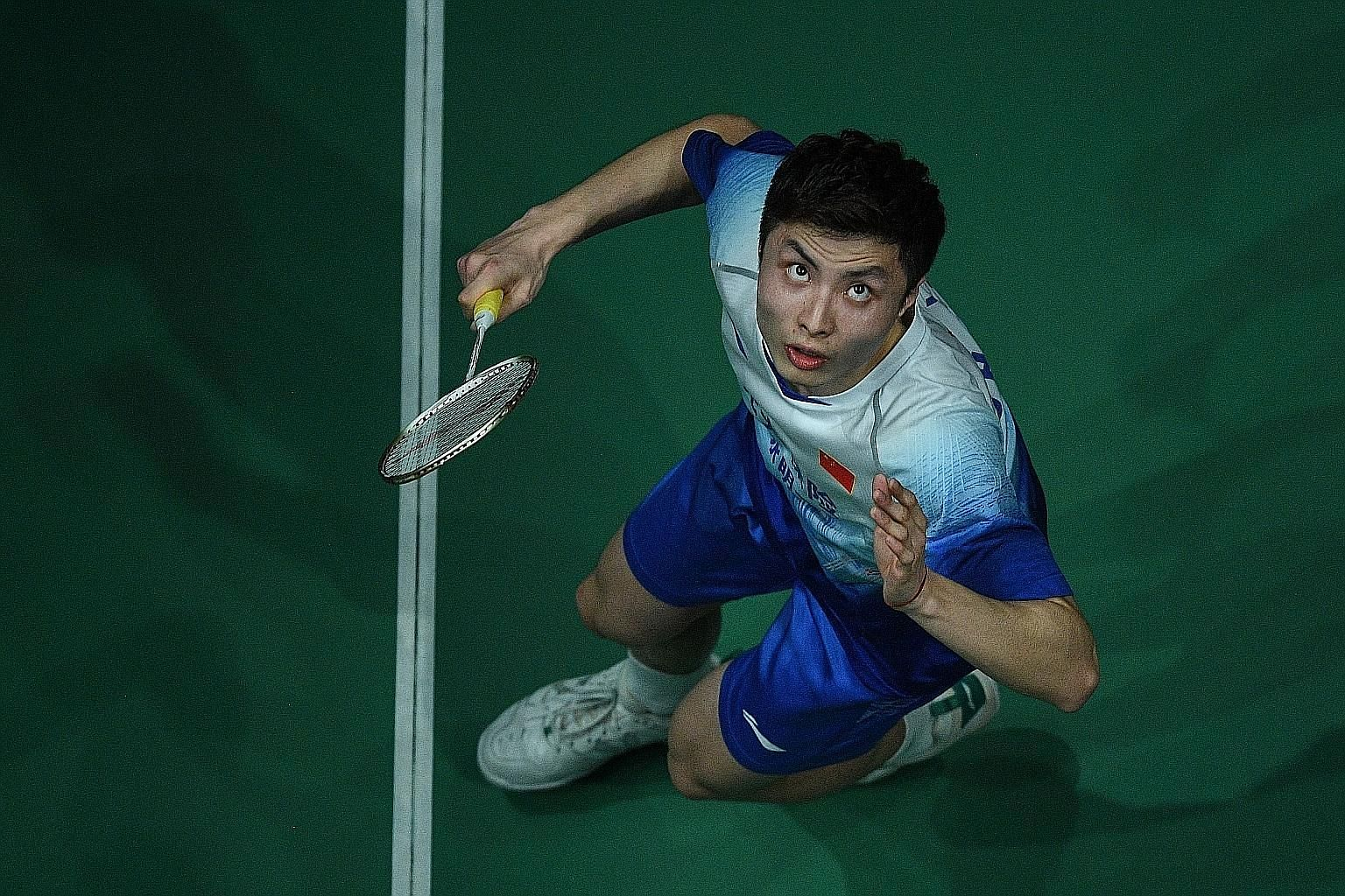 China's Olympic hope Shi Yuqi and his badminton teammates will not be barred from playing on the international circuit. PHOTO: AGENCE FRANCE-PRESSE
