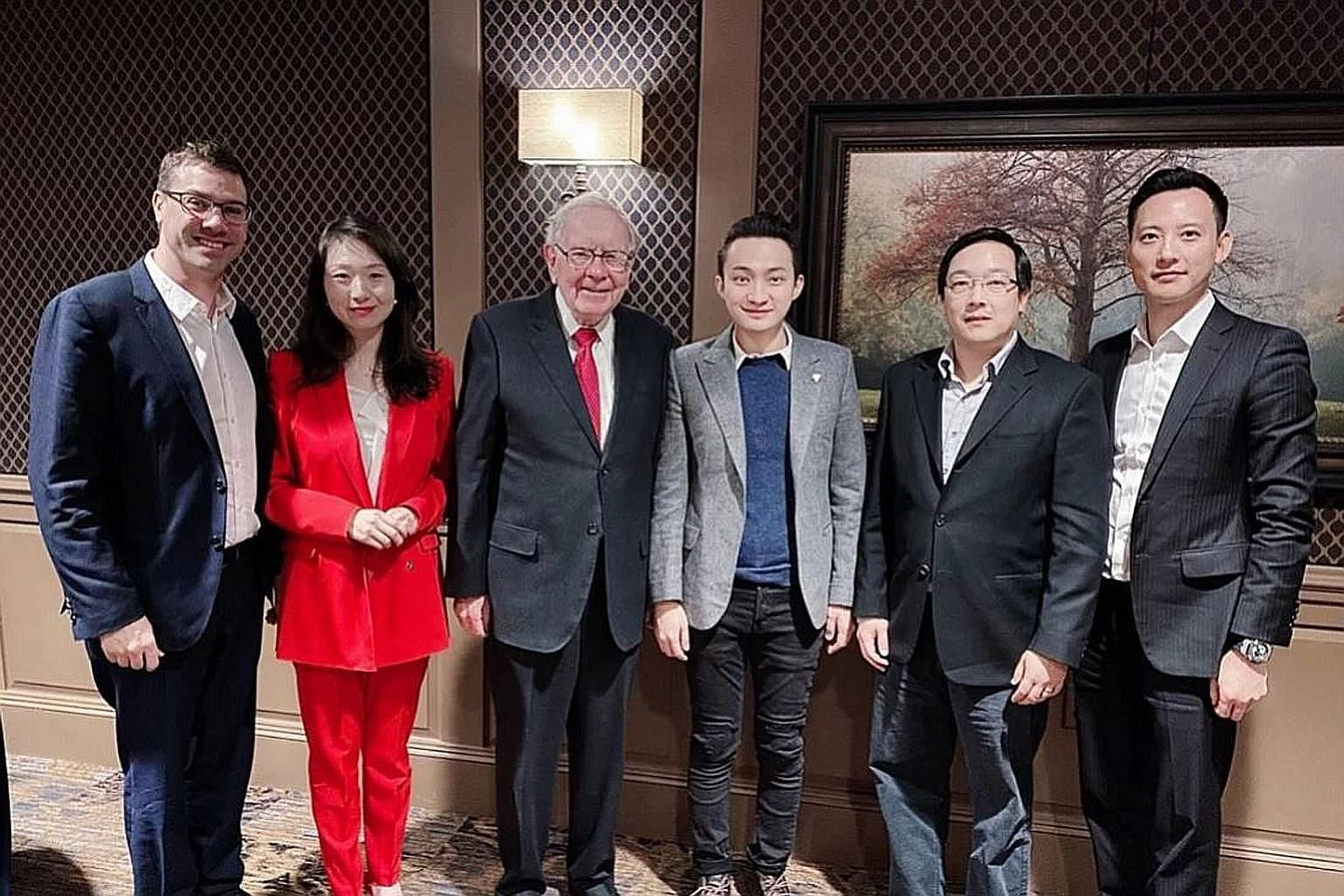 Mr Warren Buffett and Mr Justin Sun (both centre) with (from far left) eToro chief executive Yoni Assia, Binance Charity Foundation head Helen Hai, Litecoin Foundation founder Charlie Lee and Huobi chief financial officer Chris Lee during their meeti