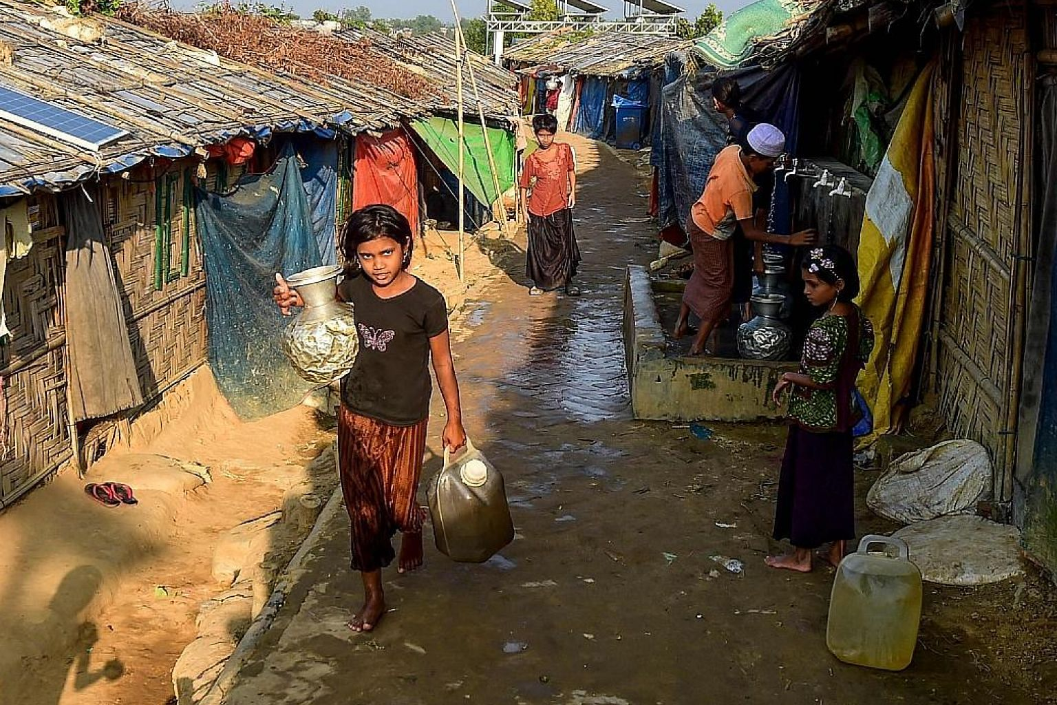 """A Rohingya refugee going home with drinking water in Jamtoli refugee camp in Ukhiya in Bangladesh in December. Through the imposition of """"provisional measures"""" on Myanmar, the ICJ has instructed the government to respect the certitudes of the Genocid"""