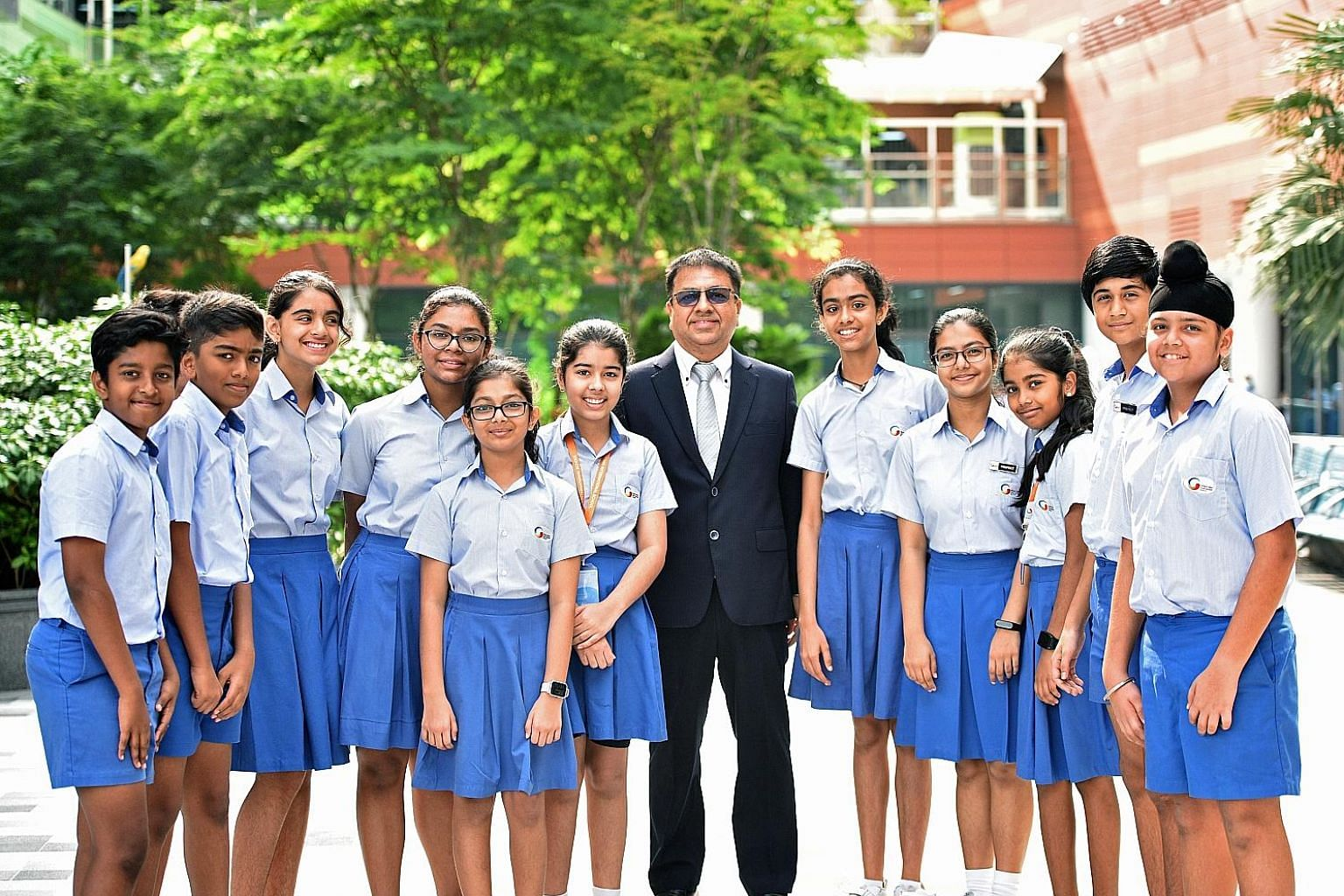 GIIS founder Atul Temurnikar with some students of the school, which he says is not one that works on a selective model. It accepts everybody and its challenge is to take an average cohort and raise individual performances.