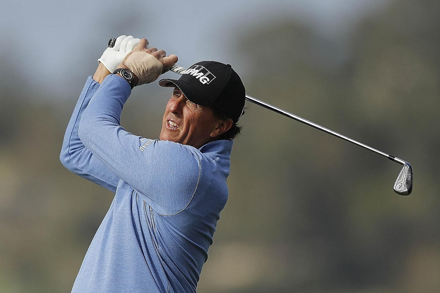 Phil Mickelson, a stroke behind leader Nick Taylor, is tied with Mark O'Meara on five wins in the Pebble Beach Pro-Am event. PHOTO: AGENCE FRANCE-PRESSE