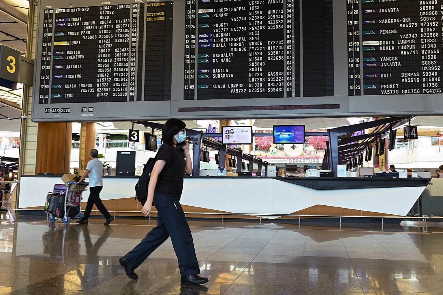 The departure hall of Singapore's Changi Airport. The writer says that as a small economy at the centre of Asia, Singapore cannot fully escape exposures such as climate change and public health issues like the current coronavirus outbreak.