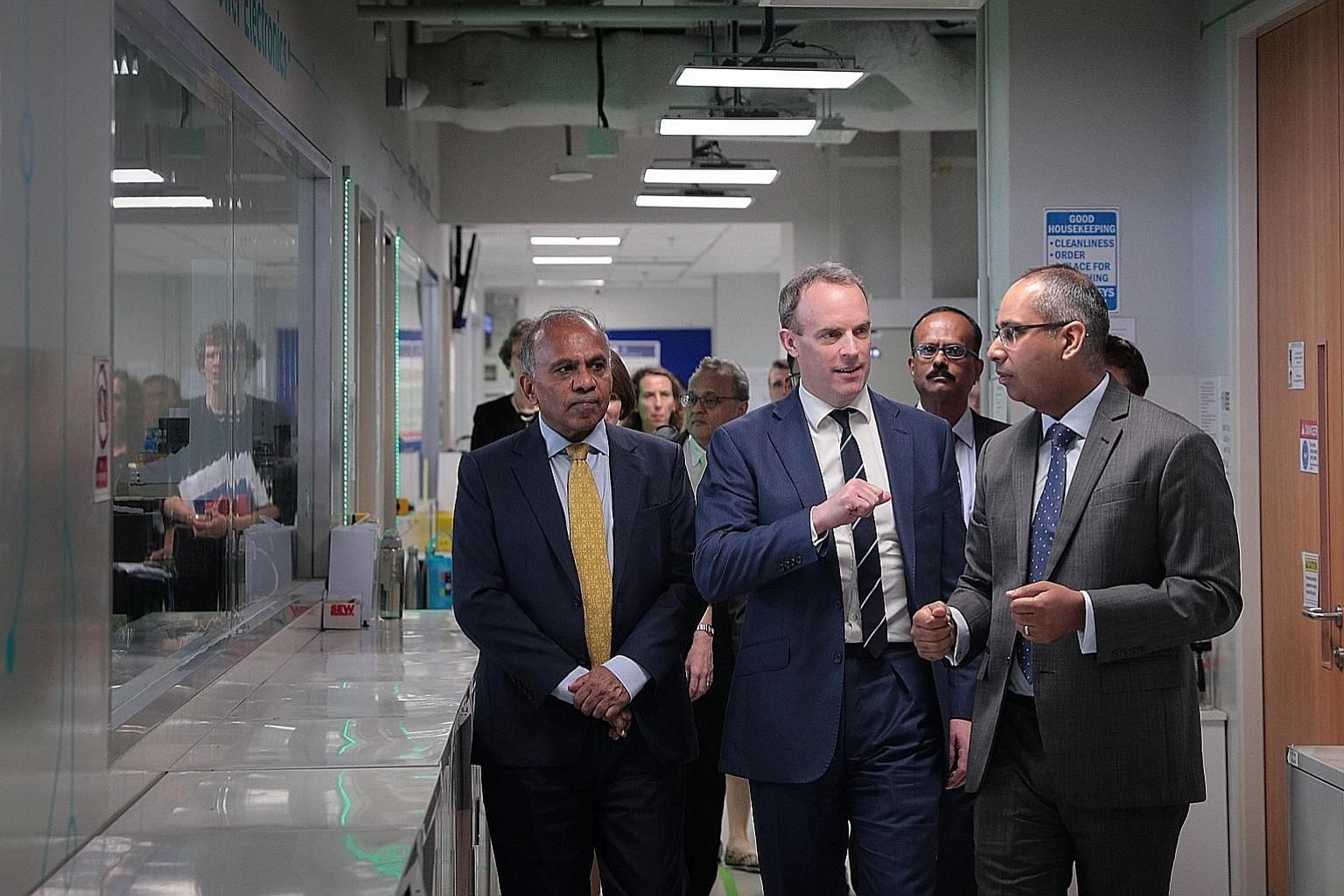 British Foreign Secretary Dominic Raab (centre) touring the Rolls-Royce corporate laboratory at Nanyang Technological University yesterday, flanked by Dr Bicky Bhangu (right), Rolls-Royce president for South-east Asia, Pacific and South Korea, and Pr