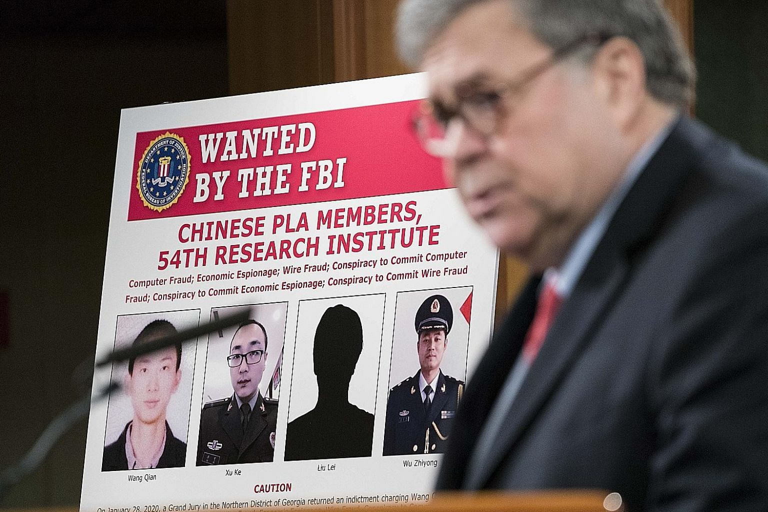 Attorney-General William Barr announced the indictments of the Chinese Liberation Army members in Washington on Monday. PHOTO: AGENCE FRANCE-PRESSE