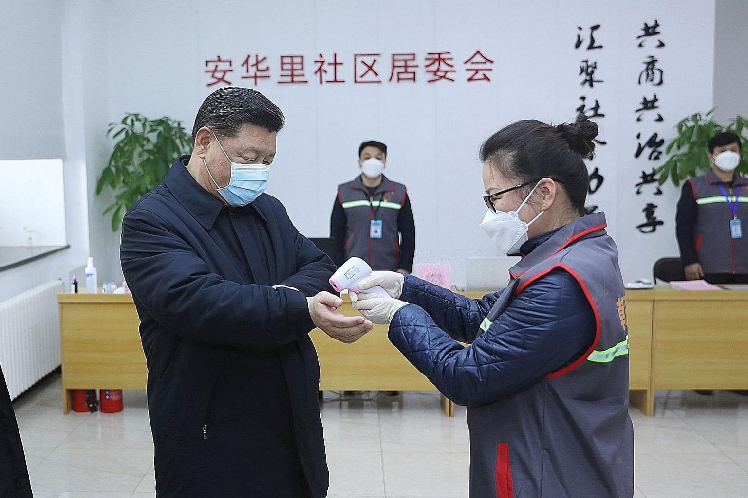 President Xi Jinping getting his temperature checked by a health official during an inspection of the coronavirus prevention and control work at the Anhuali community in Beijing, in a photo released on Monday.