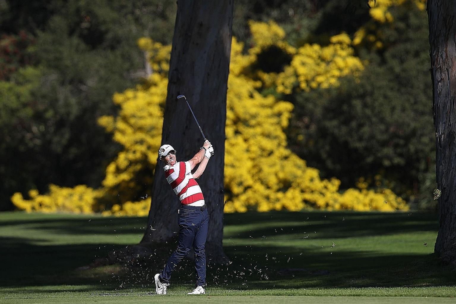Rory McIlroy taking a shot from the 13th fairway during the second round of the Genesis Invitational at Riviera Country Club in Pacific Palisades, California. The Ulsterman is tied for second after 36 holes. PHOTO: AGENCE FRANCE-PRESSE