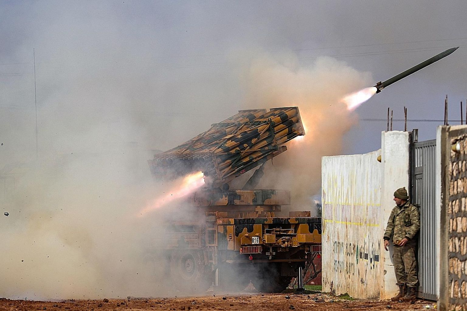A Turkish military mobile rocket launcher firing from a position in the countryside of the Syrian province of Idlib towards Syrian government forces' positions in neighbouring Aleppo province last Friday. Hundreds of civilians have been killed and 80