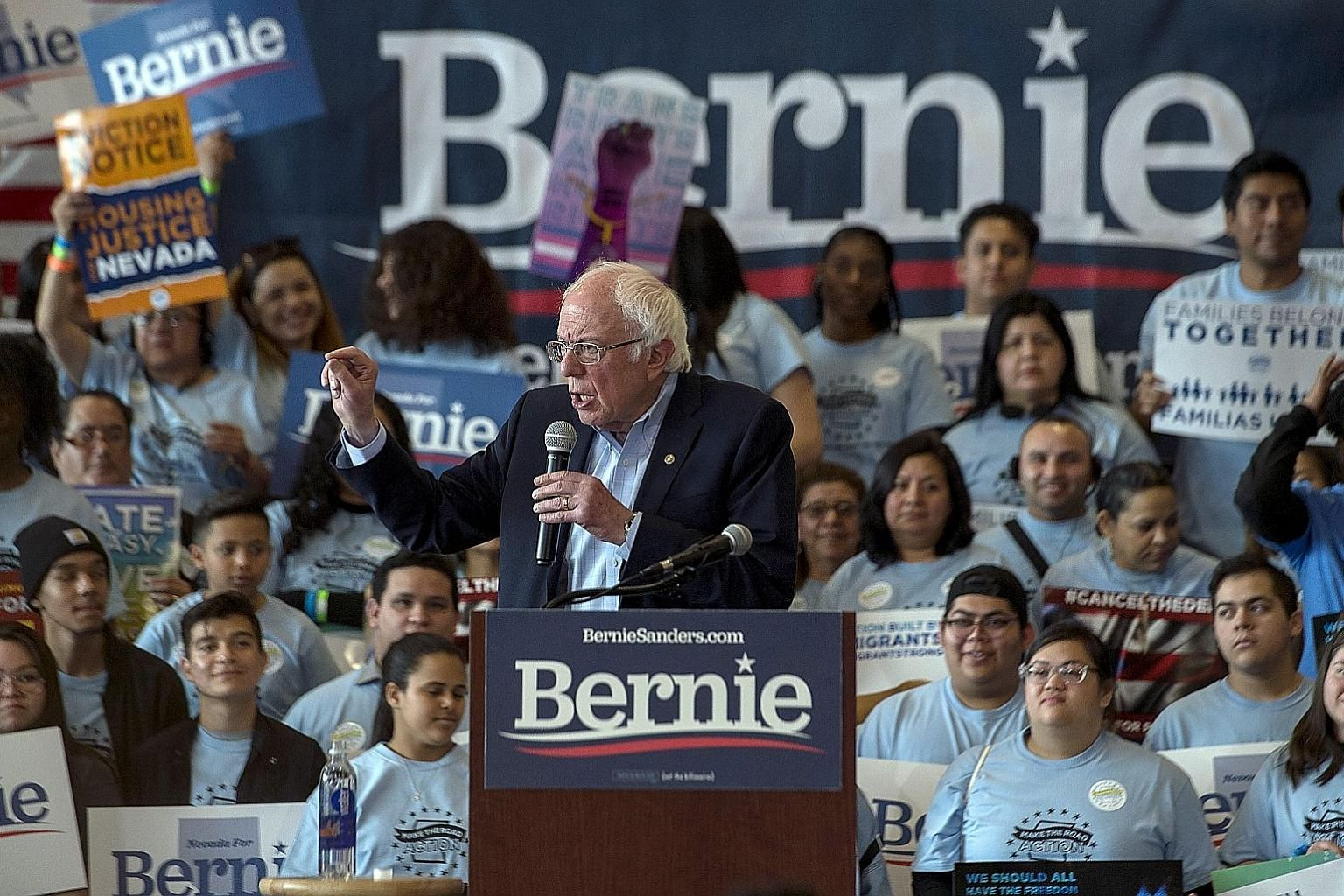 Mr Bernie Sanders (above) at a campaign rally in Las Vegas on Saturday. He was called out on his supporters' behaviour by rival Joe Biden (above, right). PHOTOS: NYTIMES, AGENCE FRANCE-PRESSE