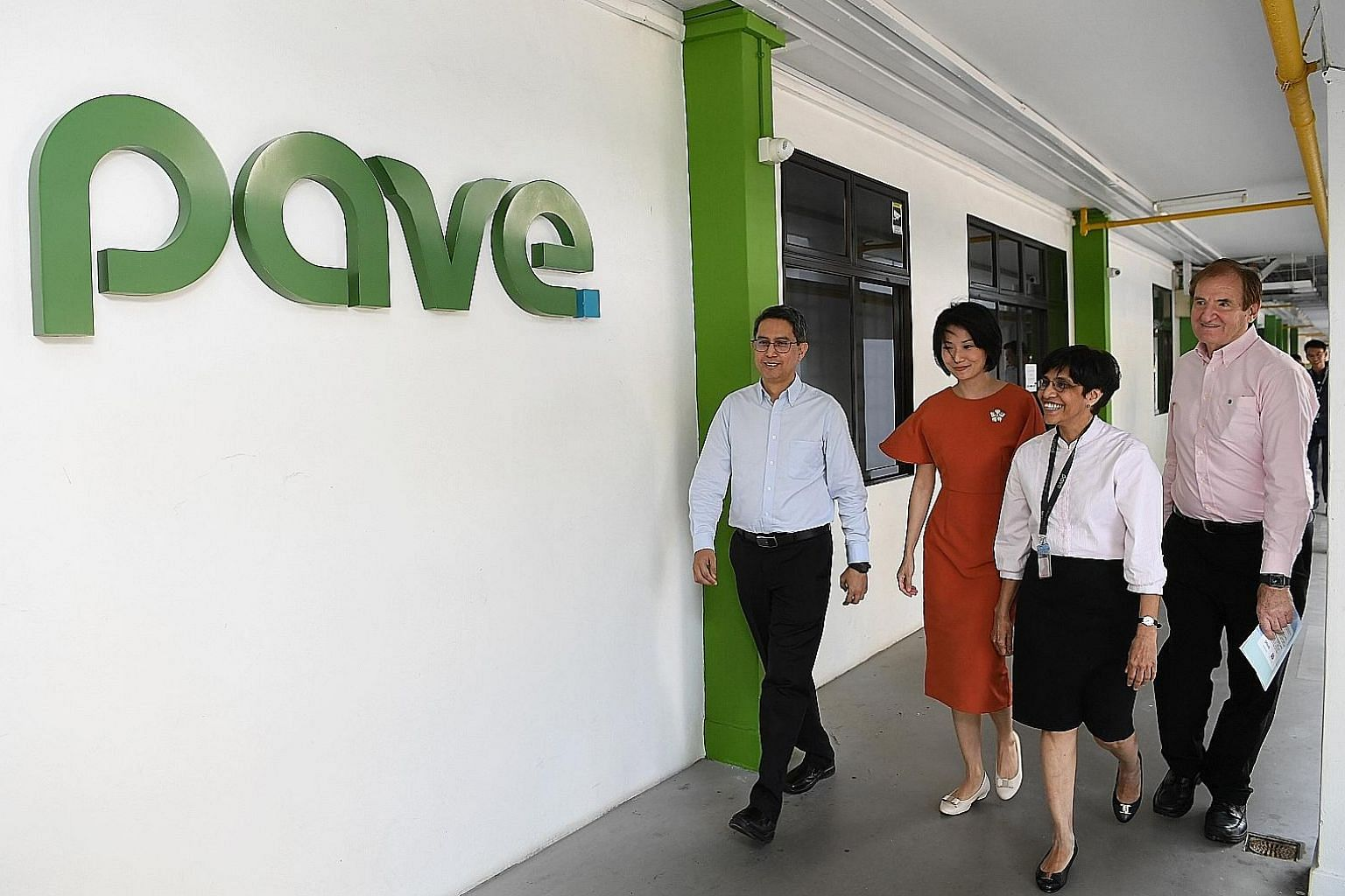(From left) Senior Parliamentary Secretary for Social and Family Development Muhammad Faishal Ibrahim and Senior Parliamentary Secretary for Home Affairs Sun Xueling, with Pave's executive director Sudha Nair and president Michael Gray at the centre'