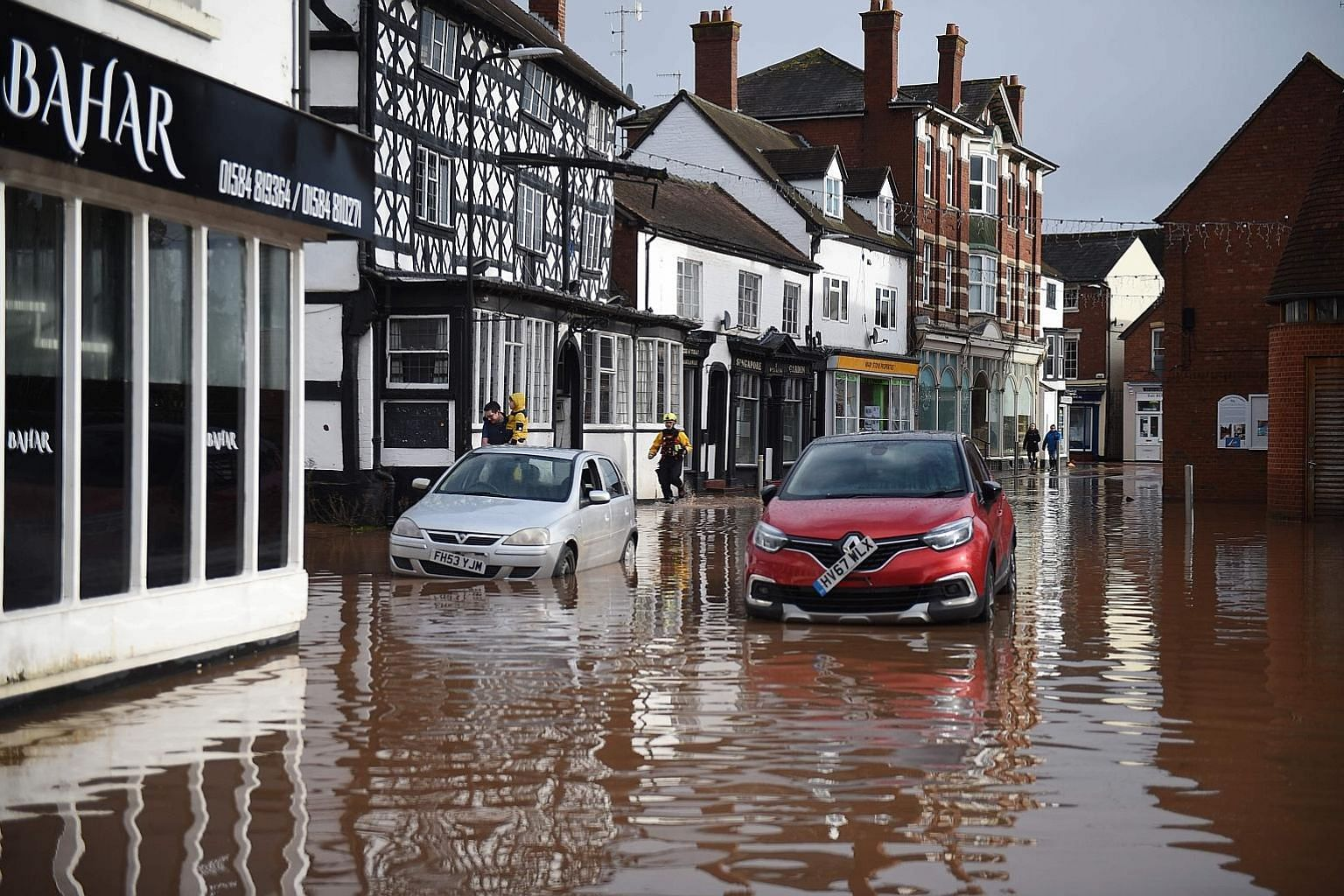 A flooded high street in Tenbury Wells in Worcestershire, western England, yesterday. More than a month's worth of rain fell in 48 hours in some parts of Britain. PHOTO: AGENCE FRANCE-PRESSE