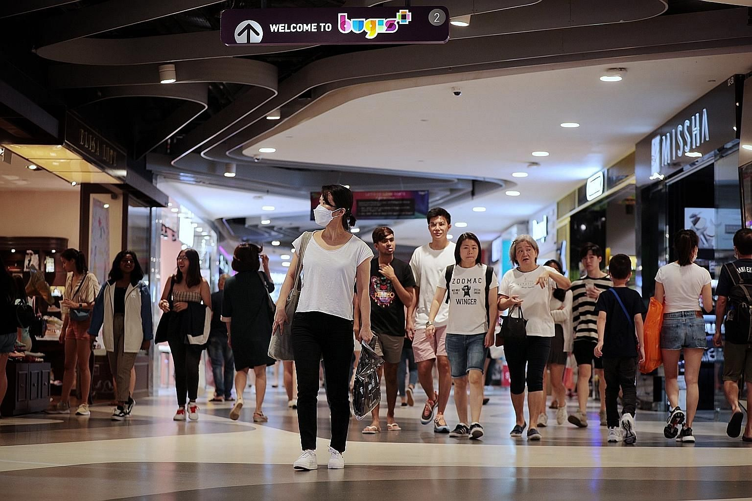 Consumers at Bugis+ shopping mall on Saturday. The coronavirus outbreak could spur more retailers to go online as shoppers avoid crowded areas and turn to e-commerce.