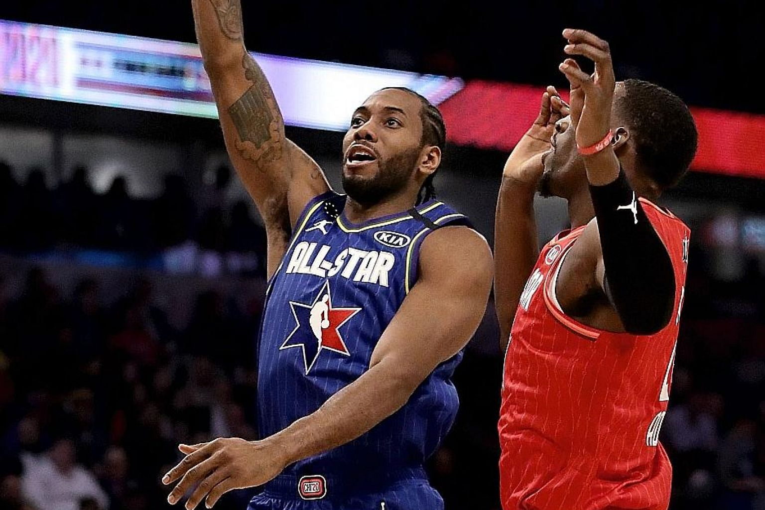 Team LeBron's Kawhi Leonard shooting over Bam Adebayo of Team Giannis during the NBA All-Star Game. Leonard was named the All-Star Most Valuable Player for his game-high 30 points. PHOTO: AGENCE FRANCE-PRESSE