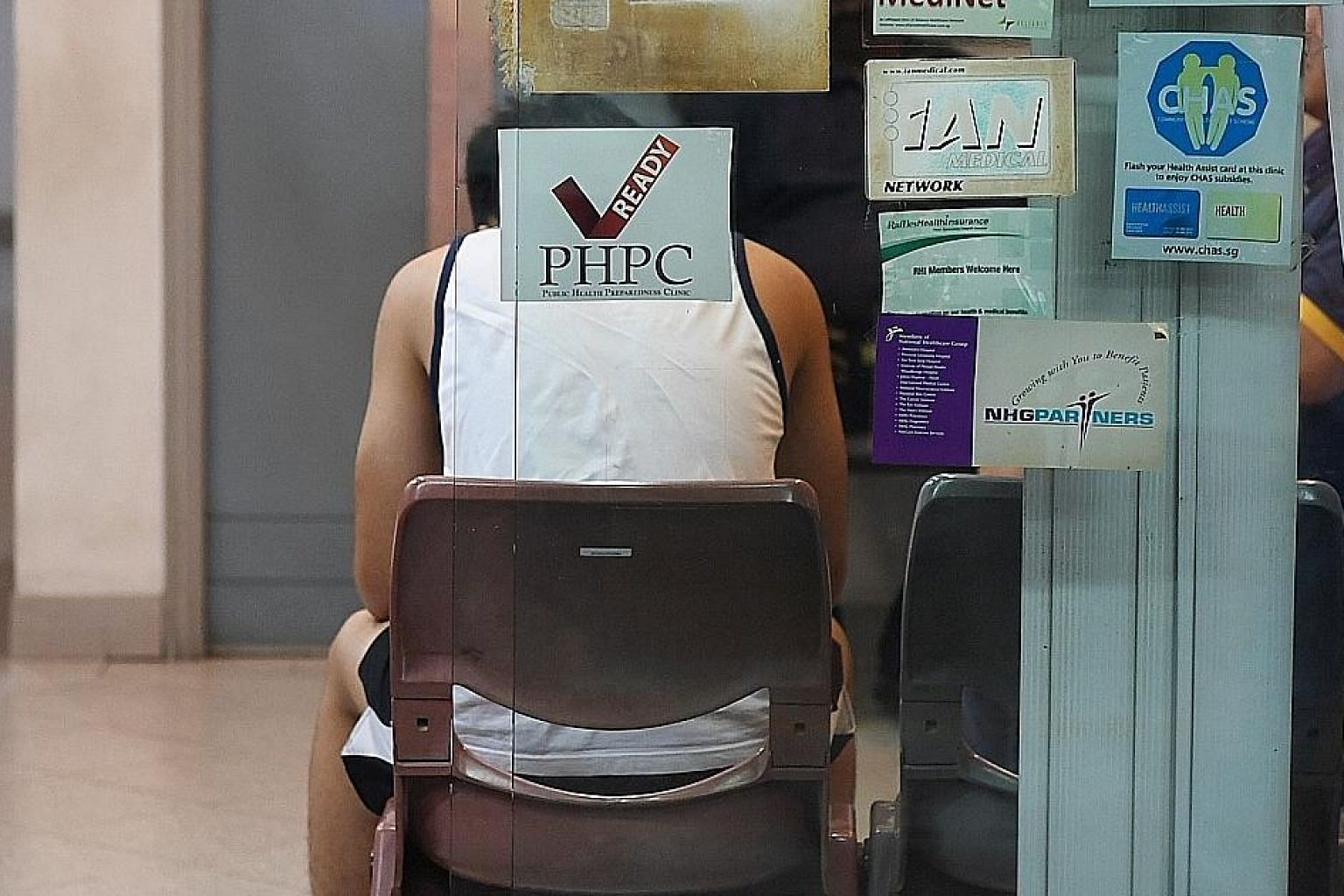 A clinic with a decal indicating that it is part of the network of Public Health Preparedness Clinics (PHPCs), which will provide subsidised treatment to patients with respiratory symptoms.