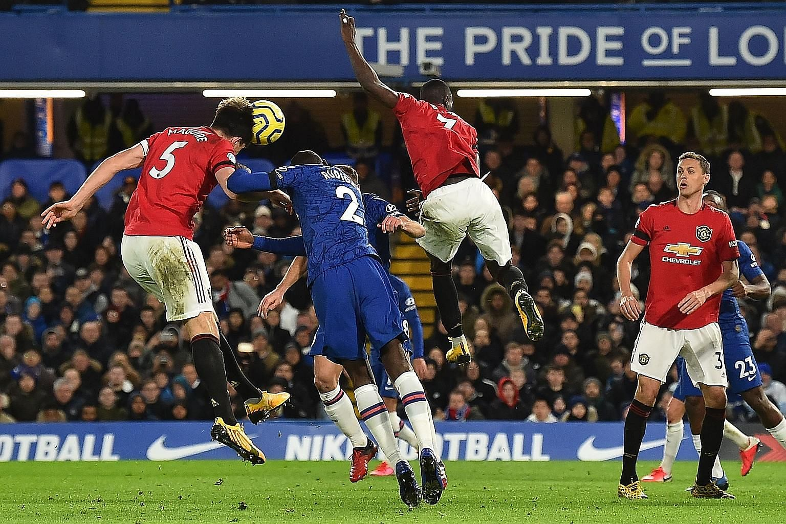 Harry Maguire (left) heading home Manchester United's second goal from a corner during their 2-0 win over Chelsea.