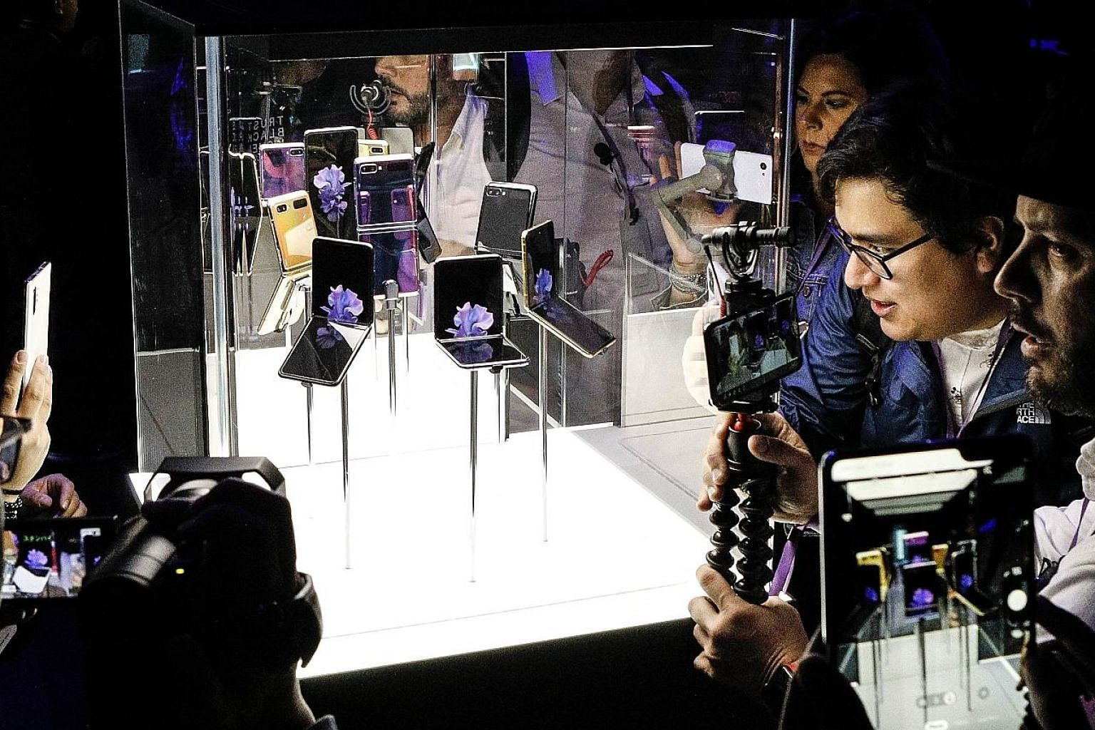 Samsung's Galaxy Z Flip smartphone on display at the Galaxy Unpacked event at the Palace of Fine Arts in San Francisco on Feb 11. The new Motorola Razr smartphone. The Huawei Mate X foldable smartphone.
