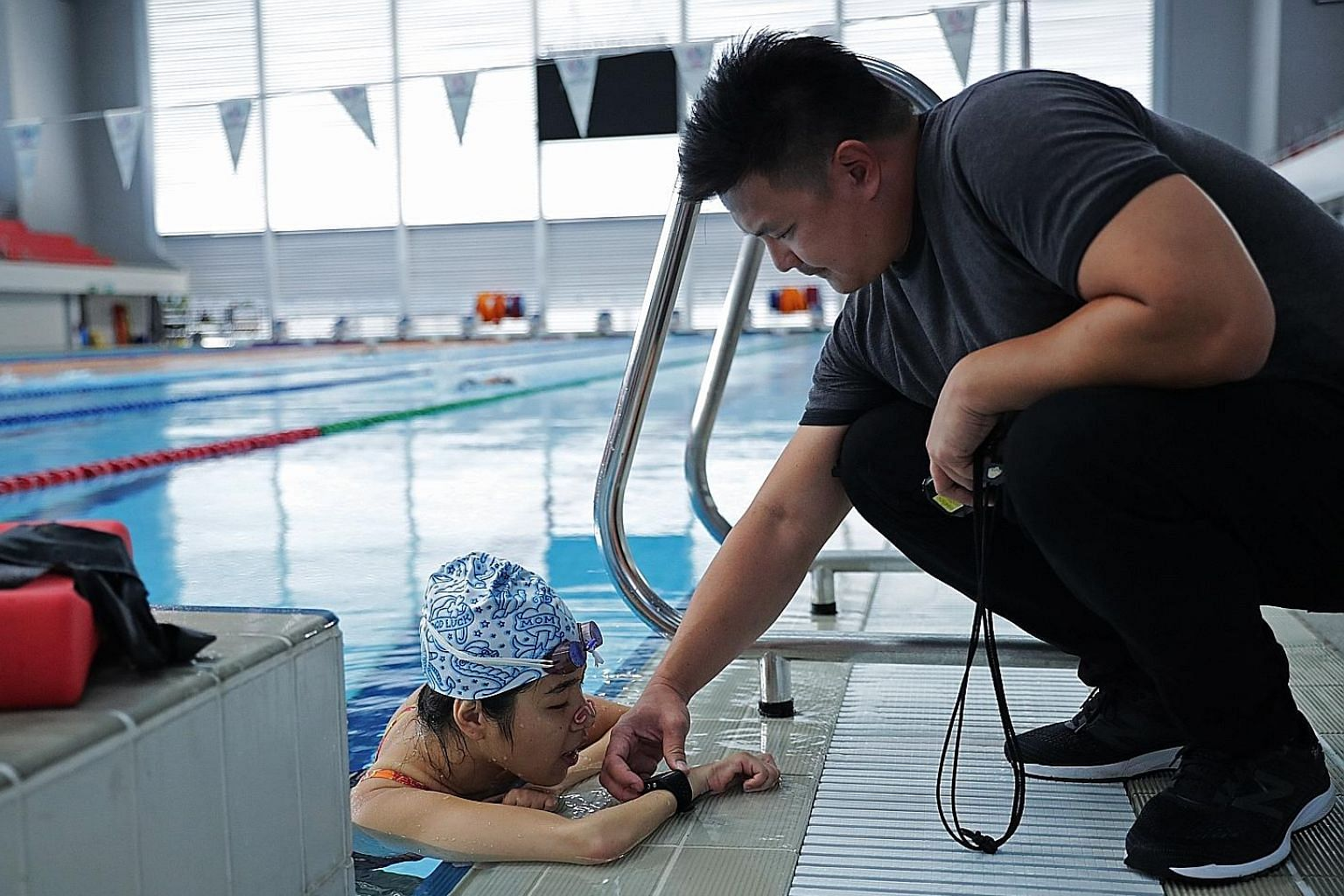 Left: Yip Pin Xiu training with coach Mark Chay at the OCBC Aquatic Centre last week. Above: Mick Massey will work with Yip and Chay in his new role as the Singapore Disability Sports Council's performance director.