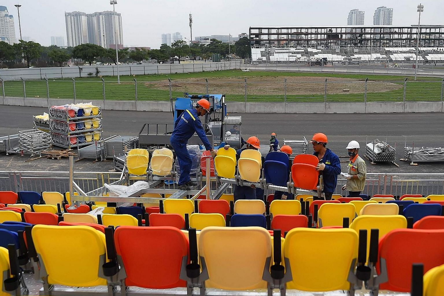 Workers fixing the chairs for the grandstand at the Formula One racetrack in Hanoi. The inaugural Vietnam Grand Prix is set for April 5.