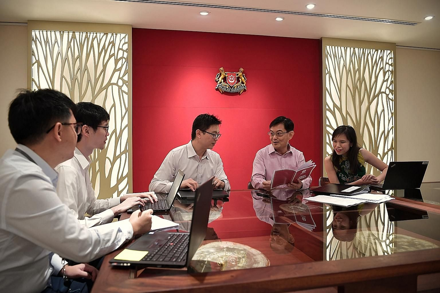Deputy Prime Minister Heng Swee Kiat with his Budget team (from far left) senior associate (land and infrastructure programmes) Zhang Wenbo, 30; head (economic programmes) Jeremy Auw, 31; deputy director (reserves and investment) Alex Poon, 37; and s