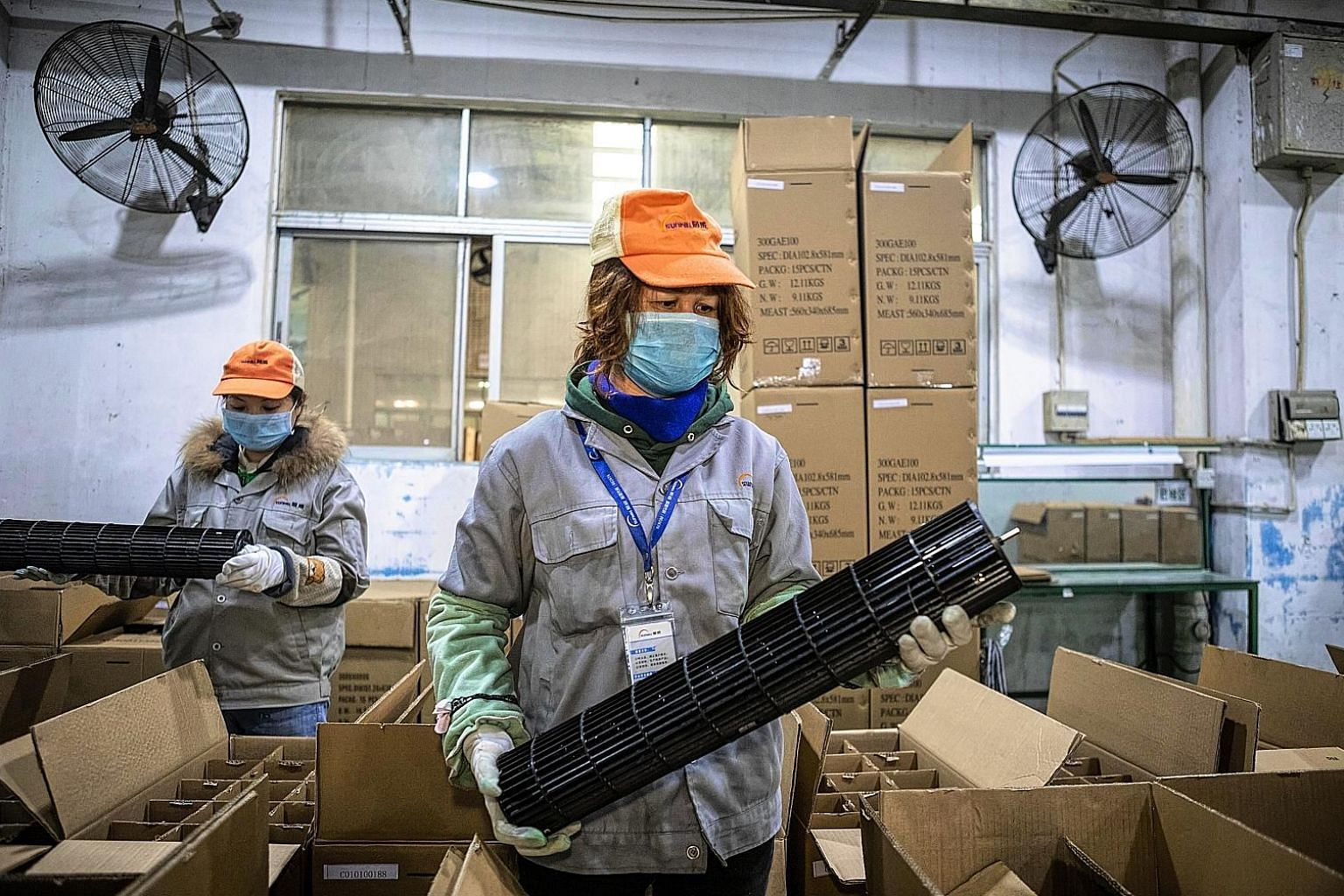 Factory workers in Foshan, China, where many factories have been closed because of the coronavirus outbreak. Individual psychology affects companies, with investment and supply-chain decisions governed by projections about demand during an epidemic a