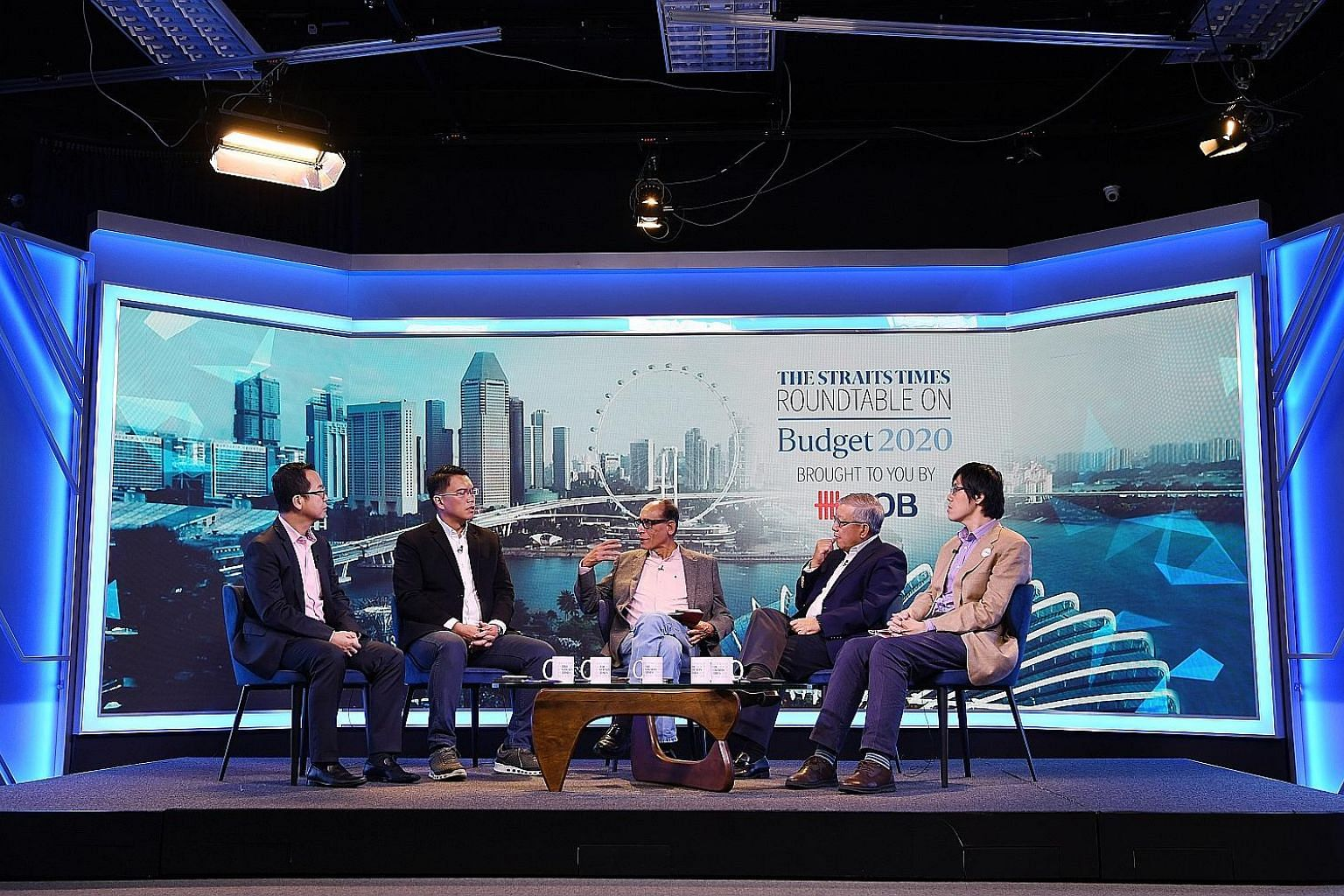 Moderated by ST associate editor Vikram Khanna (middle), the panellists - (from left) UOB senior economist Alvin Liew, Labour MP and NTUC assistant secretary-general Patrick Tay, Singapore Business Federation CEO Ho Meng Kit, and NMP and SUSS associa