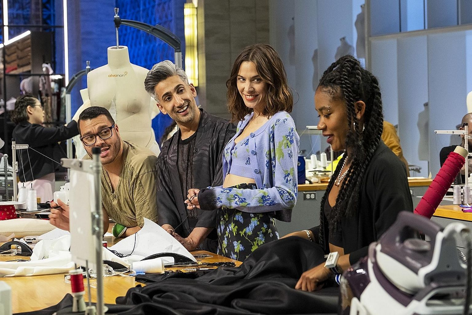 Next In Fashion hosts Tan France (second from left) and fashion personality Alexa Chung (third from left) with contestants Adolfo Sanchez (far left) and Claire Davis (right).