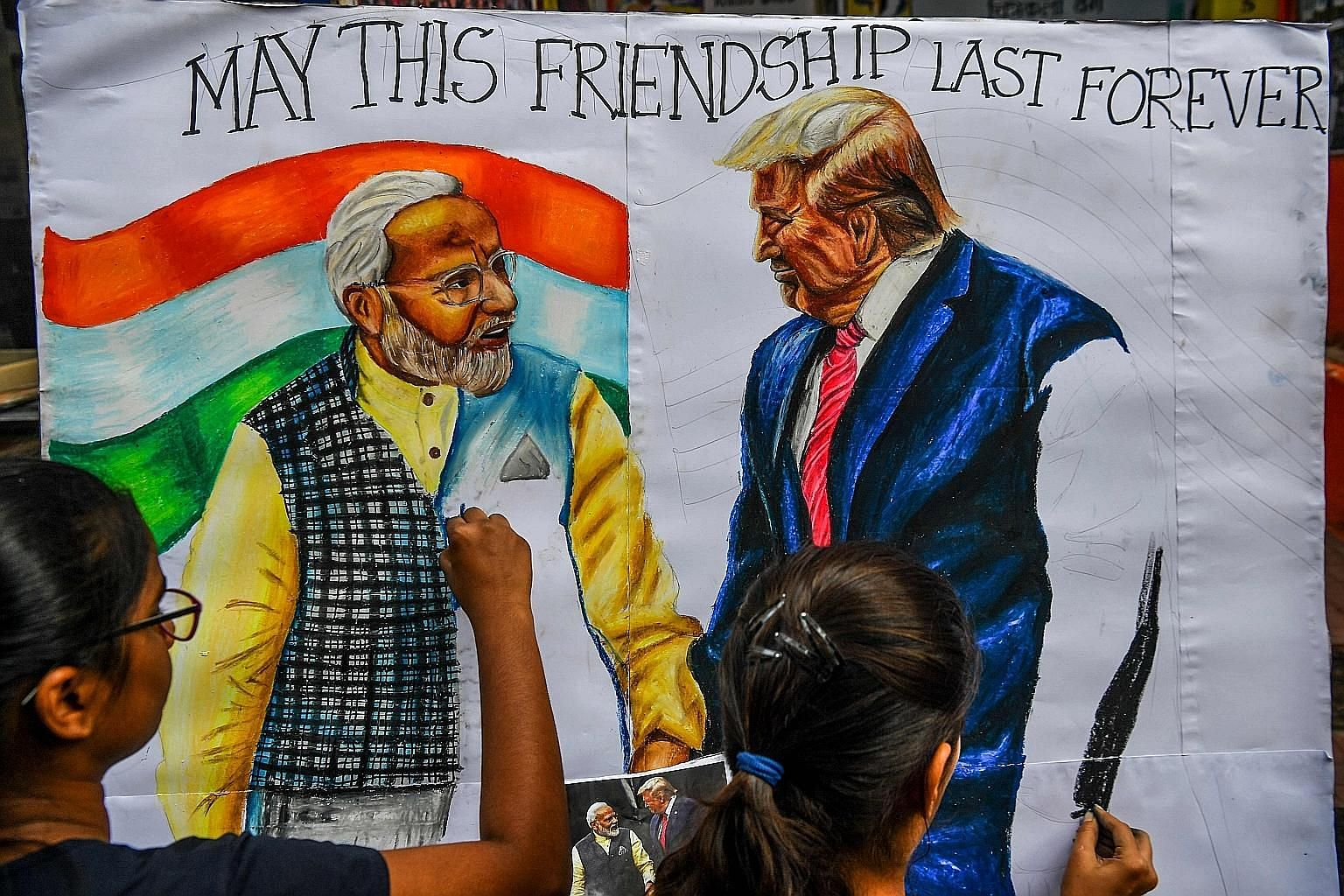 Mumbai students painting a portrait of Indian Prime Minister Narendra Modi and United States President Donald Trump on Friday. While both are undisputed leaders in their parties, they are concerned about their upcoming electoral prospects, says one w