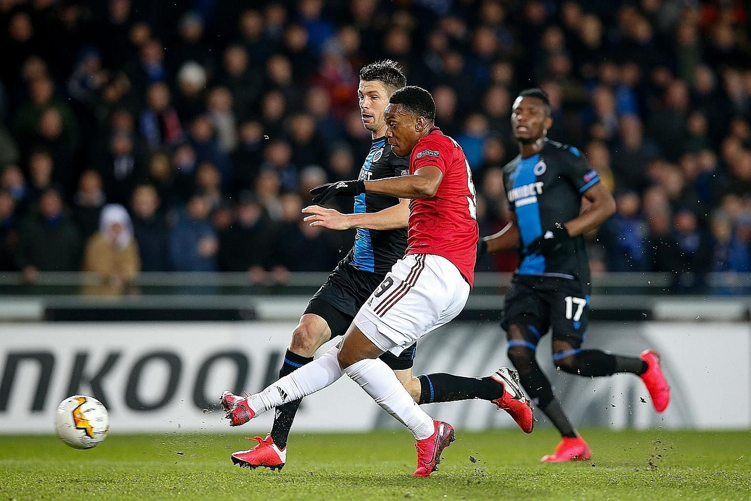Manchester United forward Anthony Martial equalising in the 1-1 Europa League last-32, first-leg draw against Club Brugge at the Jan Breydel Stadium on Thursday. He needs three more goals to tie his season-best of 17. PHOTO: AGENCE FRANCE-PRESSE