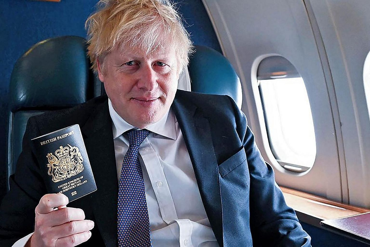 Prime Minister Boris Johnson with the new British passport. The new blue passports, being made in Poland, will replace the burgundy passports introduced in 1988. PHOTO: 10 DOWNING STREET