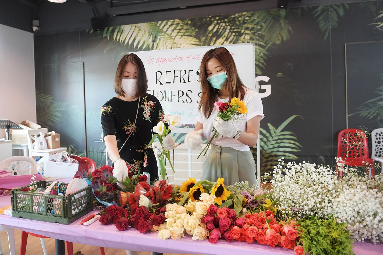 Ms Livia Chng (left) and Ms Sharon Phua from Refresh Flowers SG repurposed flowers from donated Valentine's Day bouquets for front-line and healthcare staff.