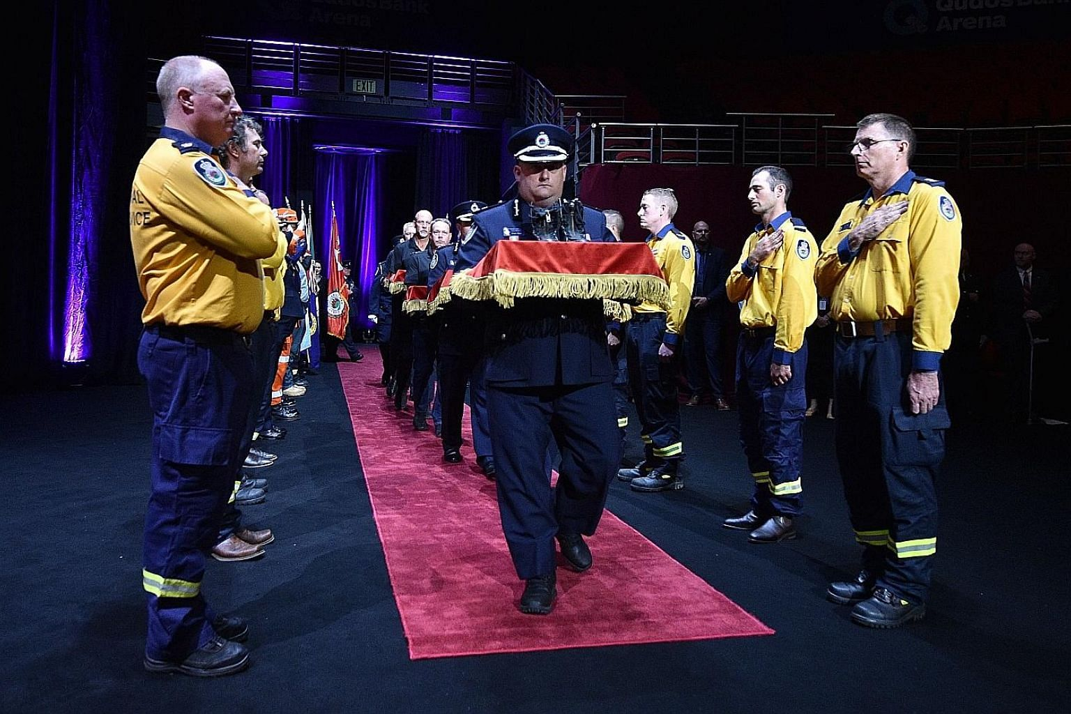 The boots of firefighters who died in the Australian bush fires being carried into a state memorial in Sydney yesterday.