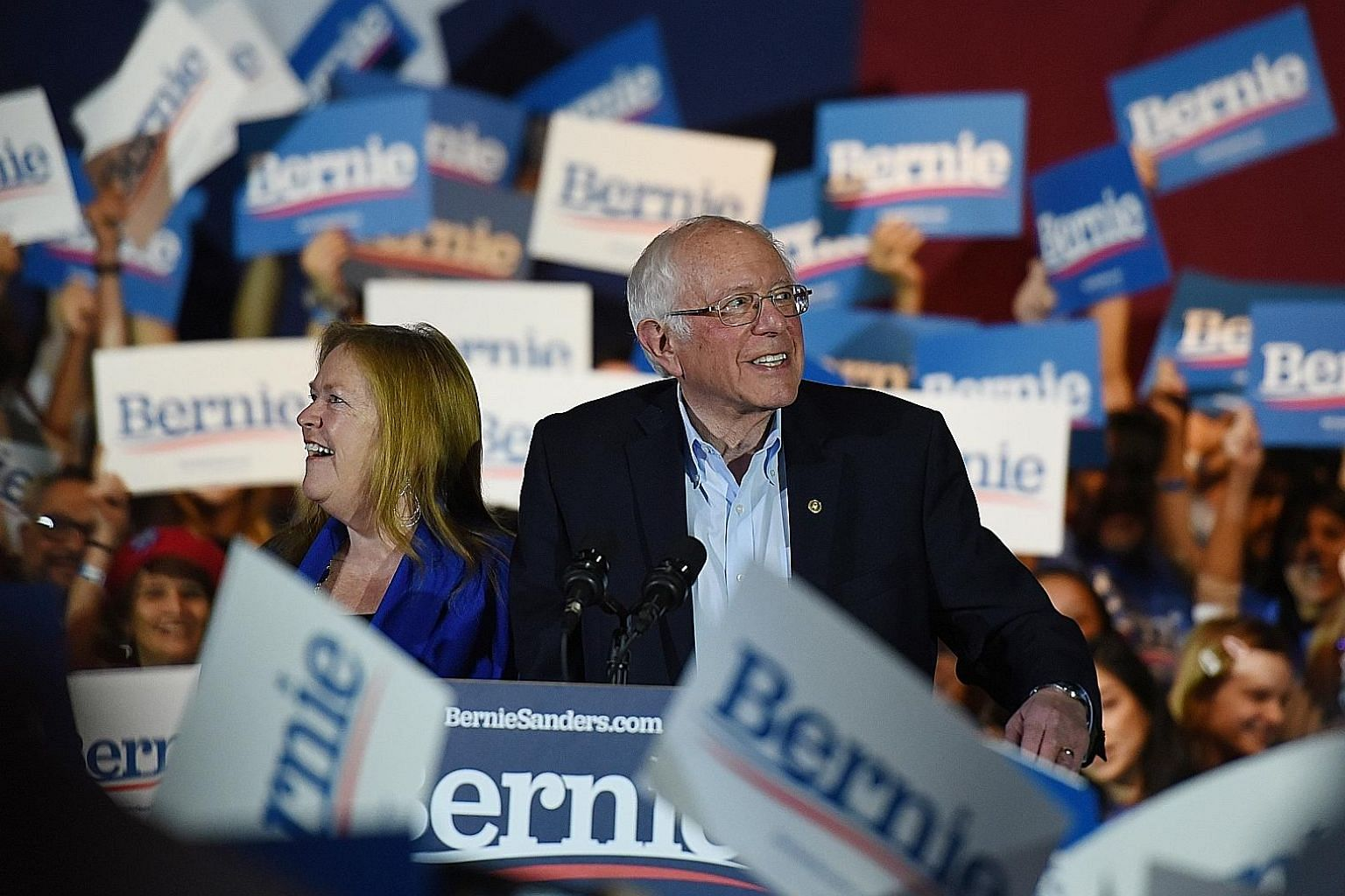 Democratic presidential hopeful Bernie Sanders celebrating with wife Jane after being declared the winner of the Nevada caucus at a campaign rally in San Antonio, Texas, on Saturday. The Vermont Senator had more than double the votes of his rivals as