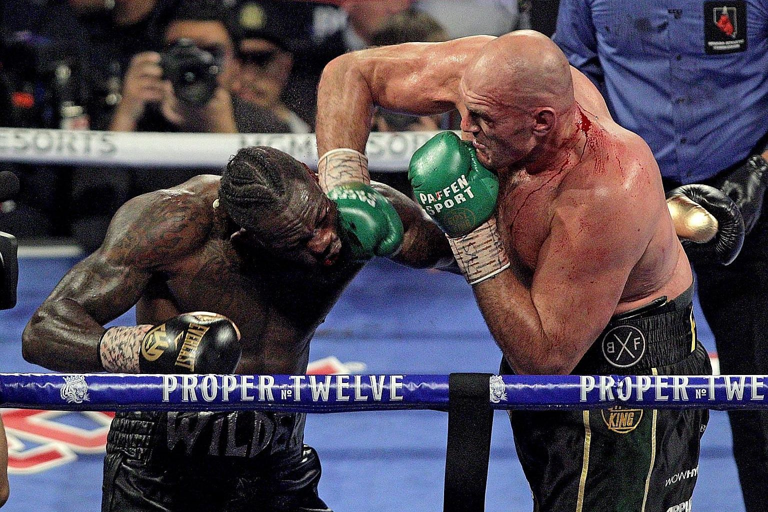 Tyson Fury landing a right to the face of Deontay Wilder during their heavyweight title bout in Las Vegas. The Briton landed 82 of 267 punches as his rival's corner threw in the towel in the seventh round.