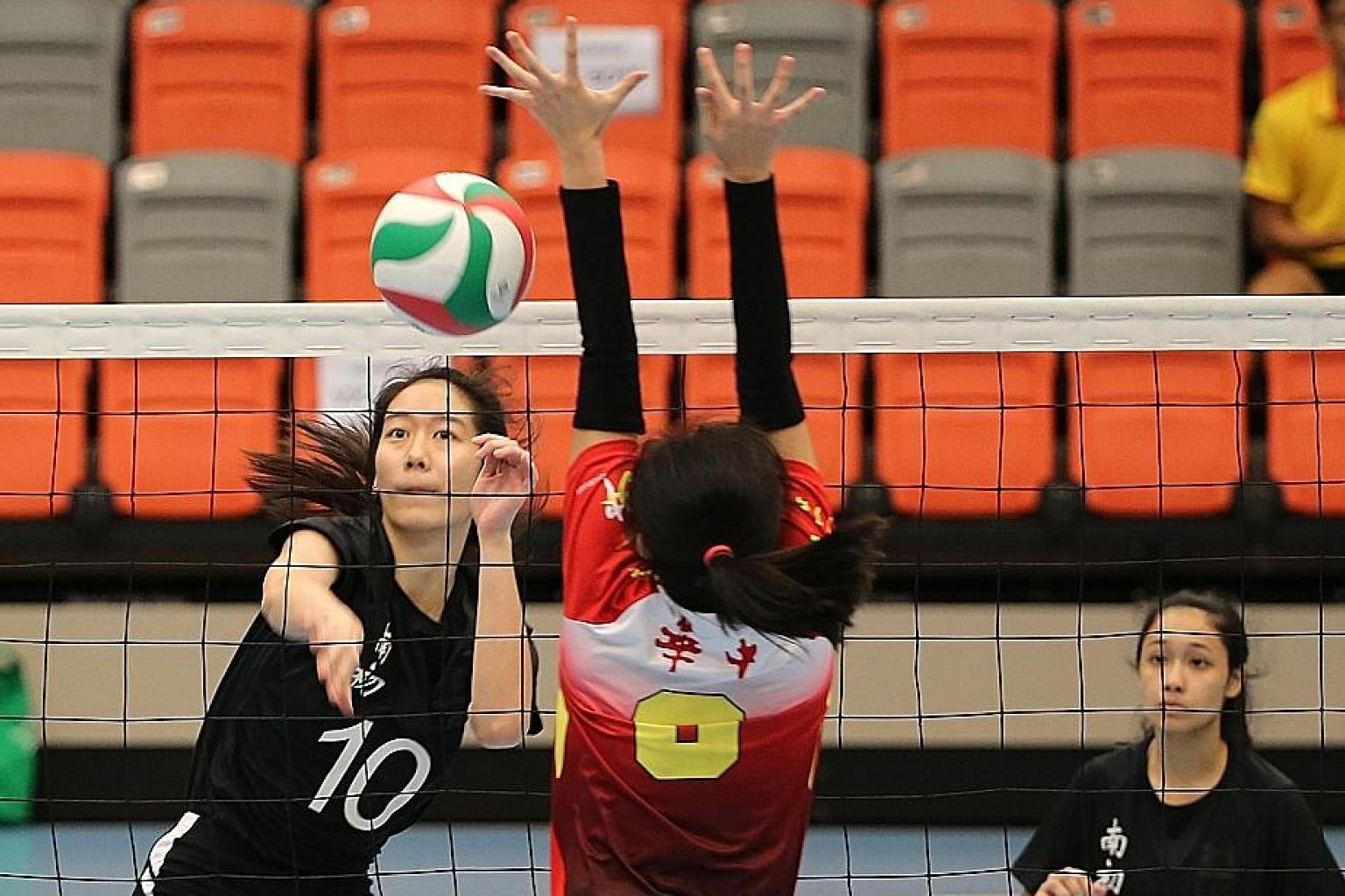 The Nanyang Junior College girls' volleyball team beating Hwa Chong Institution to win their fifth straight A Div title last year. Their hopes of extending the streak was hampered by the lack of sparring partners as their alumni were barred from returning