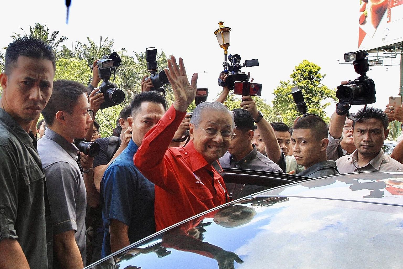 Malaysian Prime Minister Mahathir Mohamad leaving his party's headquarters yesterday in Petaling Jaya, Selangor, after a meeting. Speculation of the imminent collapse of the PH government peaked yesterday when local media reported that leaders from T