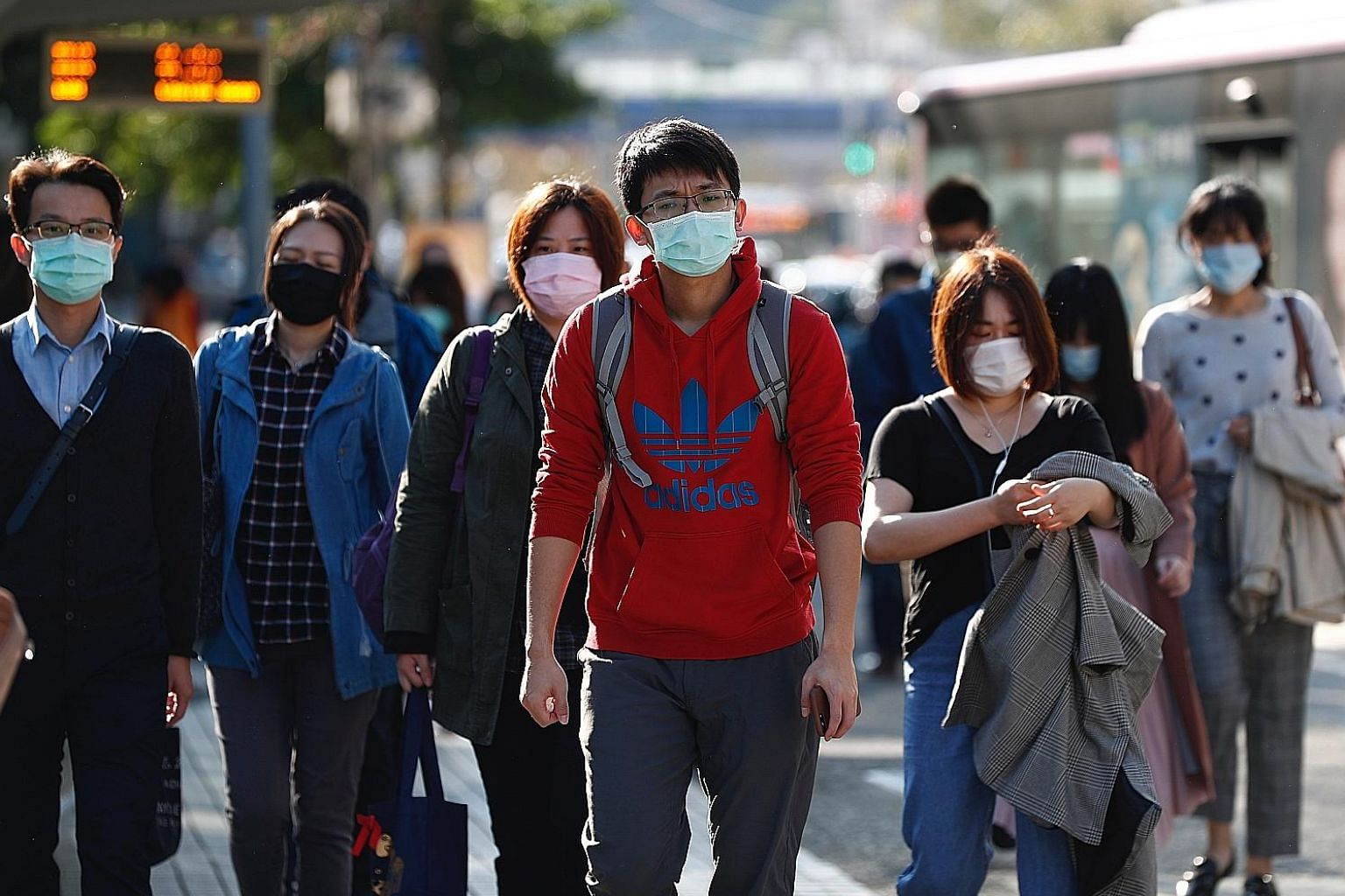 Taiwanese donning face masks in Taipei amid the coronavirus outbreak. Mistrust between Beijing and Taipei has led to acrimony in the handling of the crisis, with several hundred Taiwanese still stranded in outbreak epicentre Wuhan as both sides have