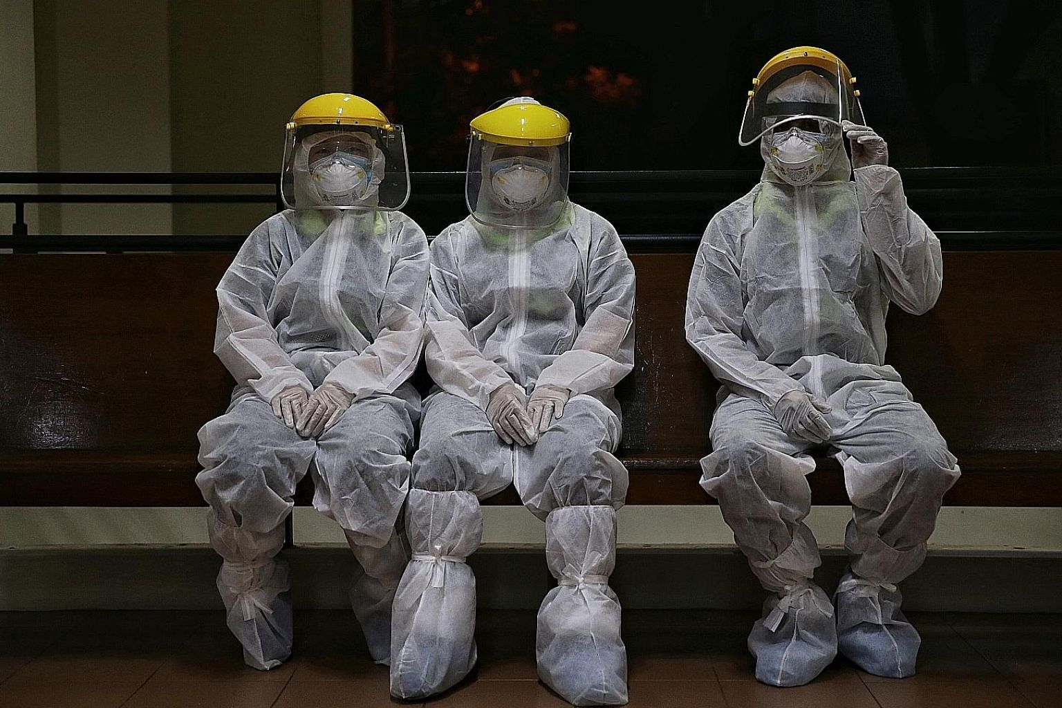 Employees from a cleaning company taking a break after disinfecting a site. Silver Ribbon executive director Porsche Poh said some people have become highly anxious about catching the coronavirus.