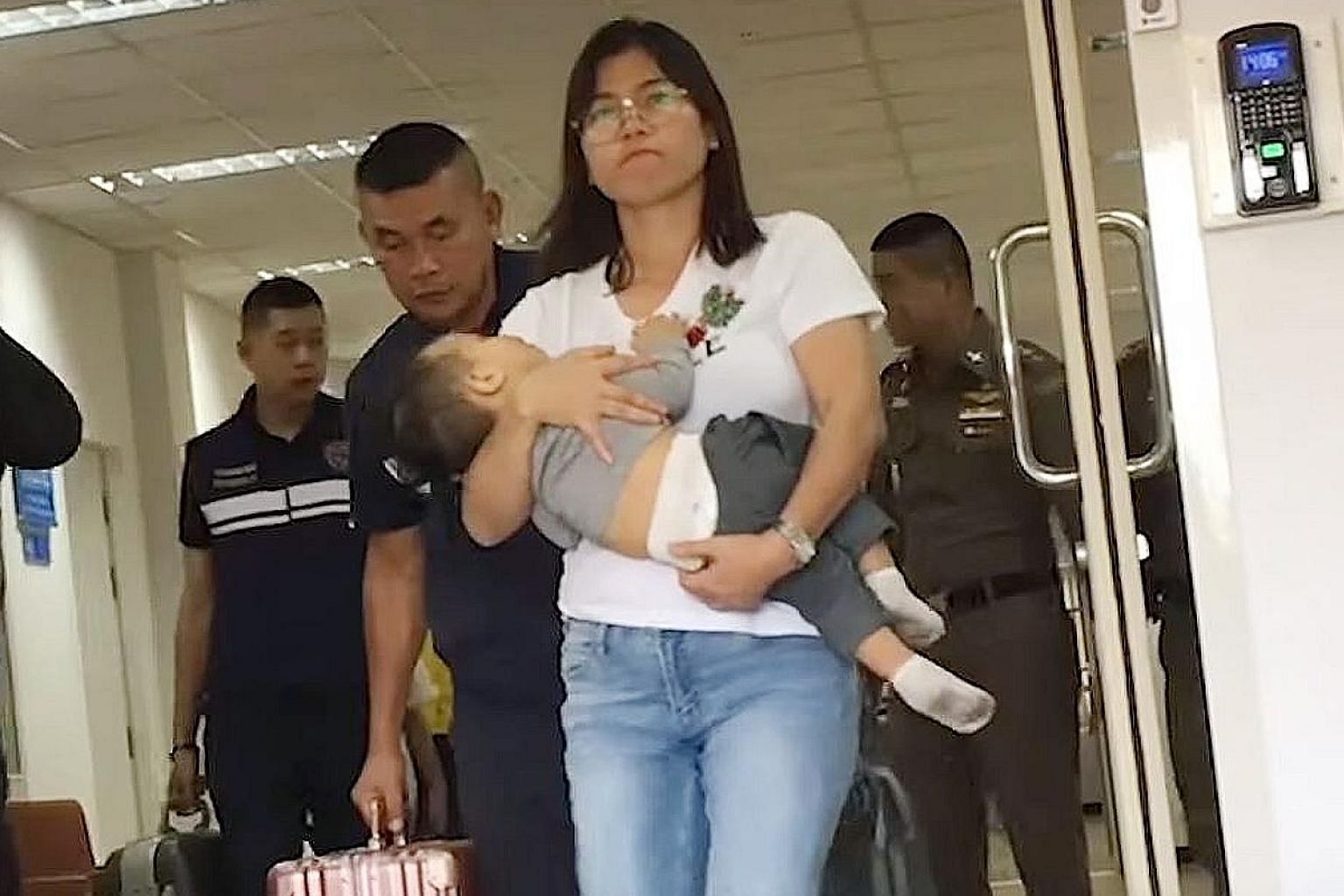 The wife of Myanmar's Arakan Army leader, Ms Hnin Zar Phyu, seen here with one of their children, had been detained in Thailand. PHOTO: RADIO FREE ASIA/YOUTUBE