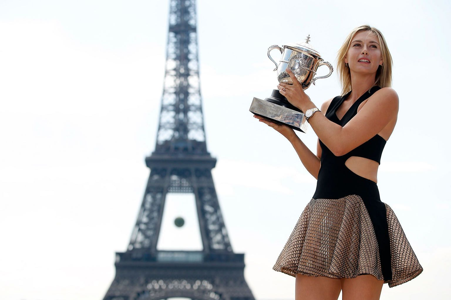 Maria Sharapova posing with the Suzanne Lenglen trophy near the Eiffel Tower after winning the 2014 French Open. PHOTOS: EPA-EFE, AGENCE FRANCE-PRESSE