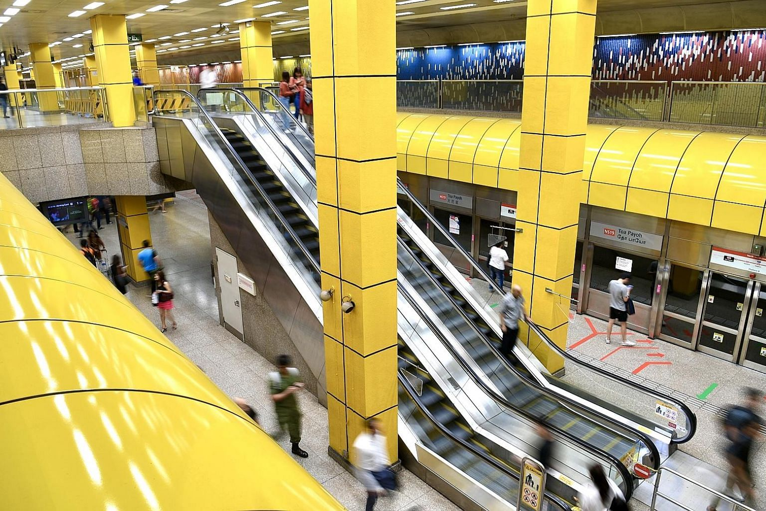 A double-volume space featuring a lofty ceiling is a hallmark of the Toa Payoh station.