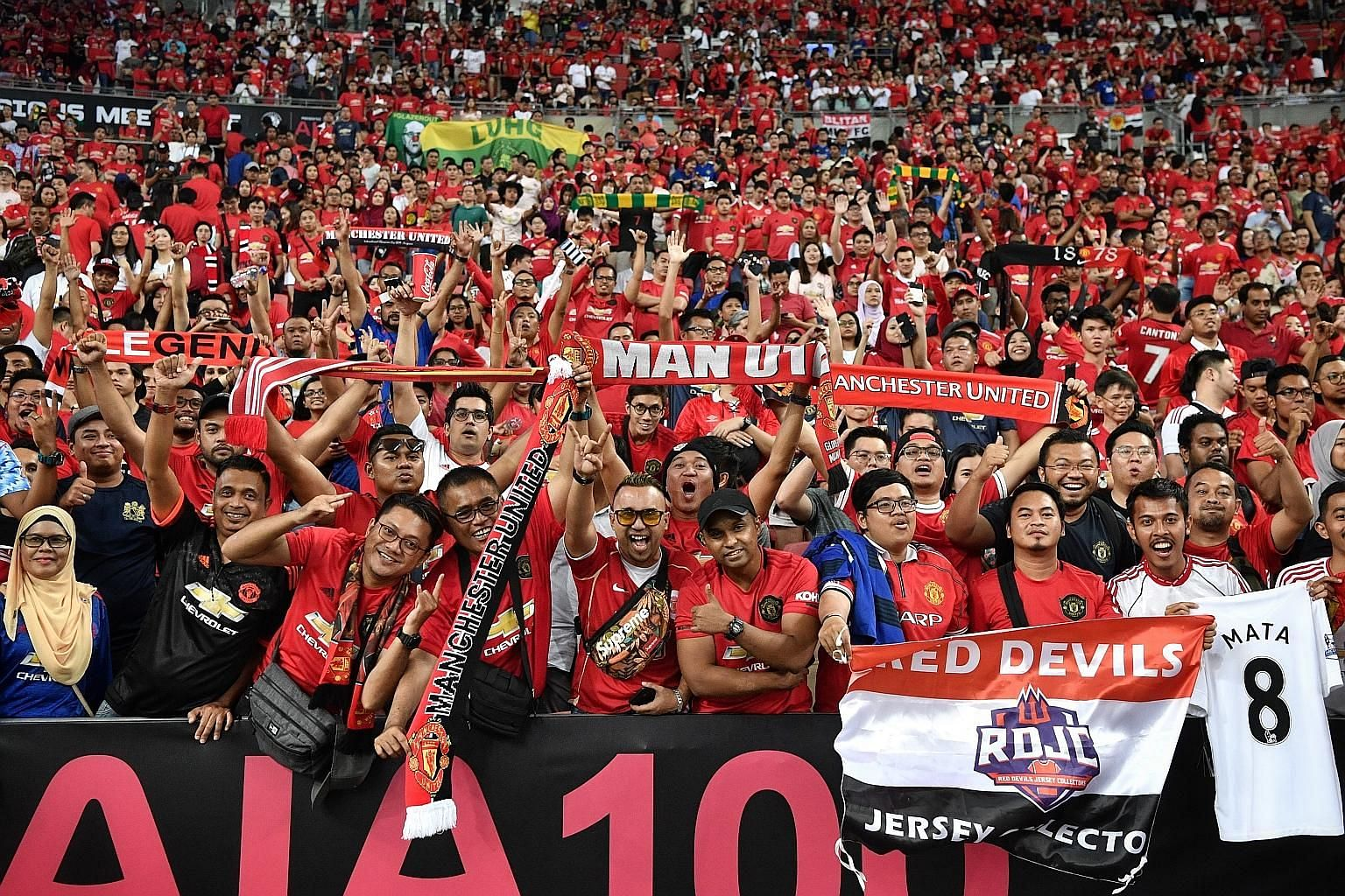 Manchester United fans packing the National Stadium last July to witness their team beat Inter Milan 1-0 in the International Champions Cup. They were part of a record 52,897 crowd. ST FILE PHOTO
